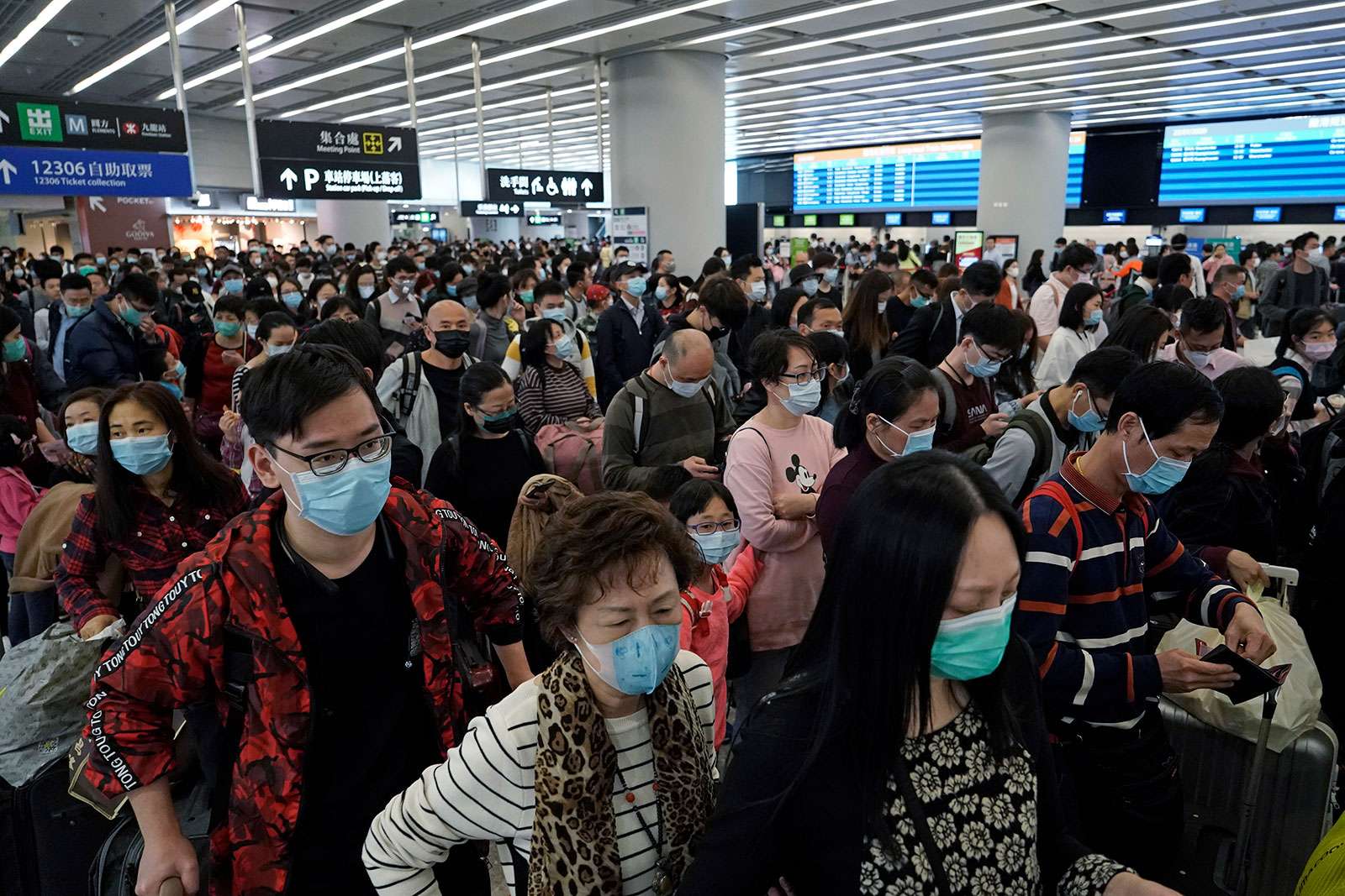 Passengers wait in the departure hall of the high speed train station in Hong Kong on January 23.