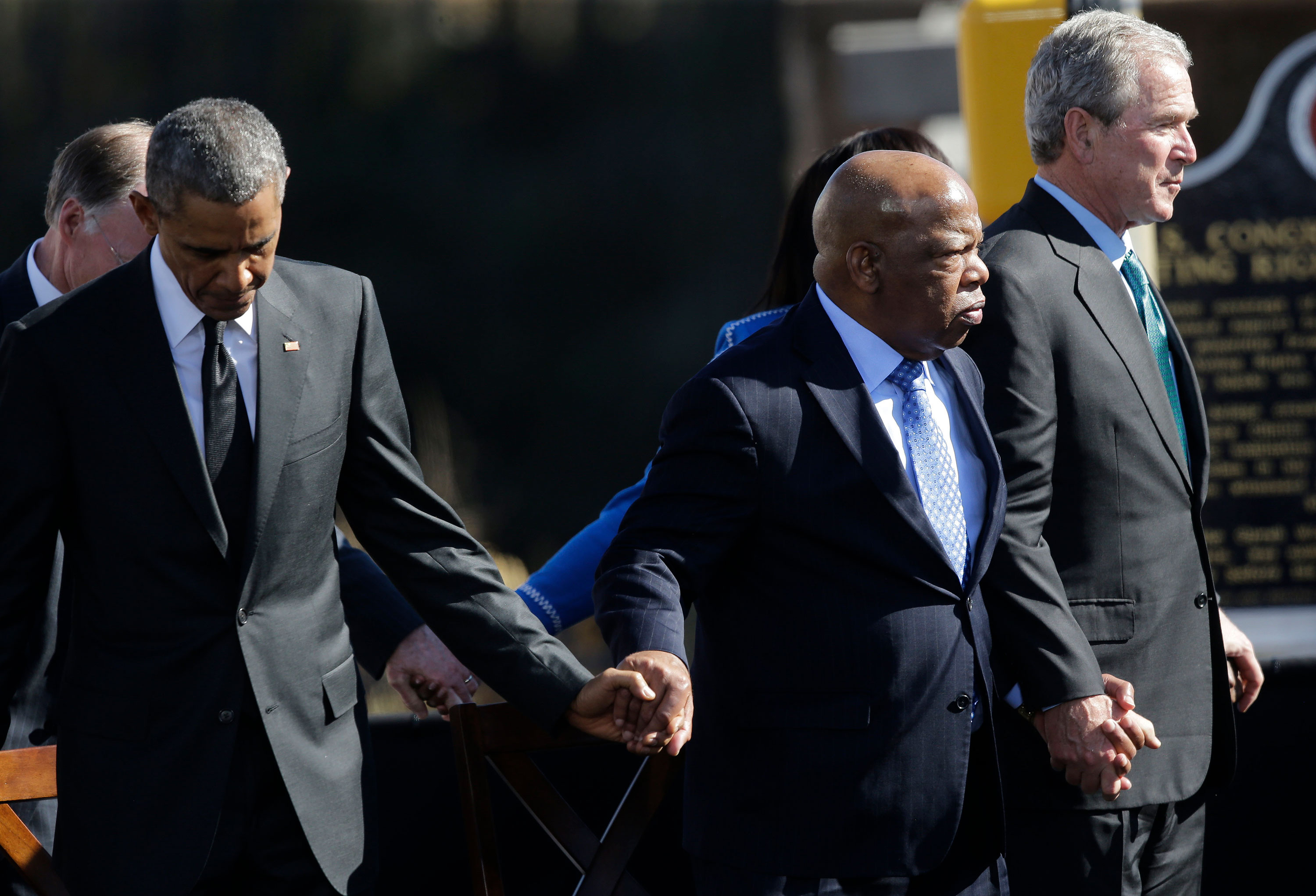 Rep. John Lewis stands with President Barack Obama and former President George W. Bush at the Edmund Pettus Bridge in Selma, Alabama, in March 2015.