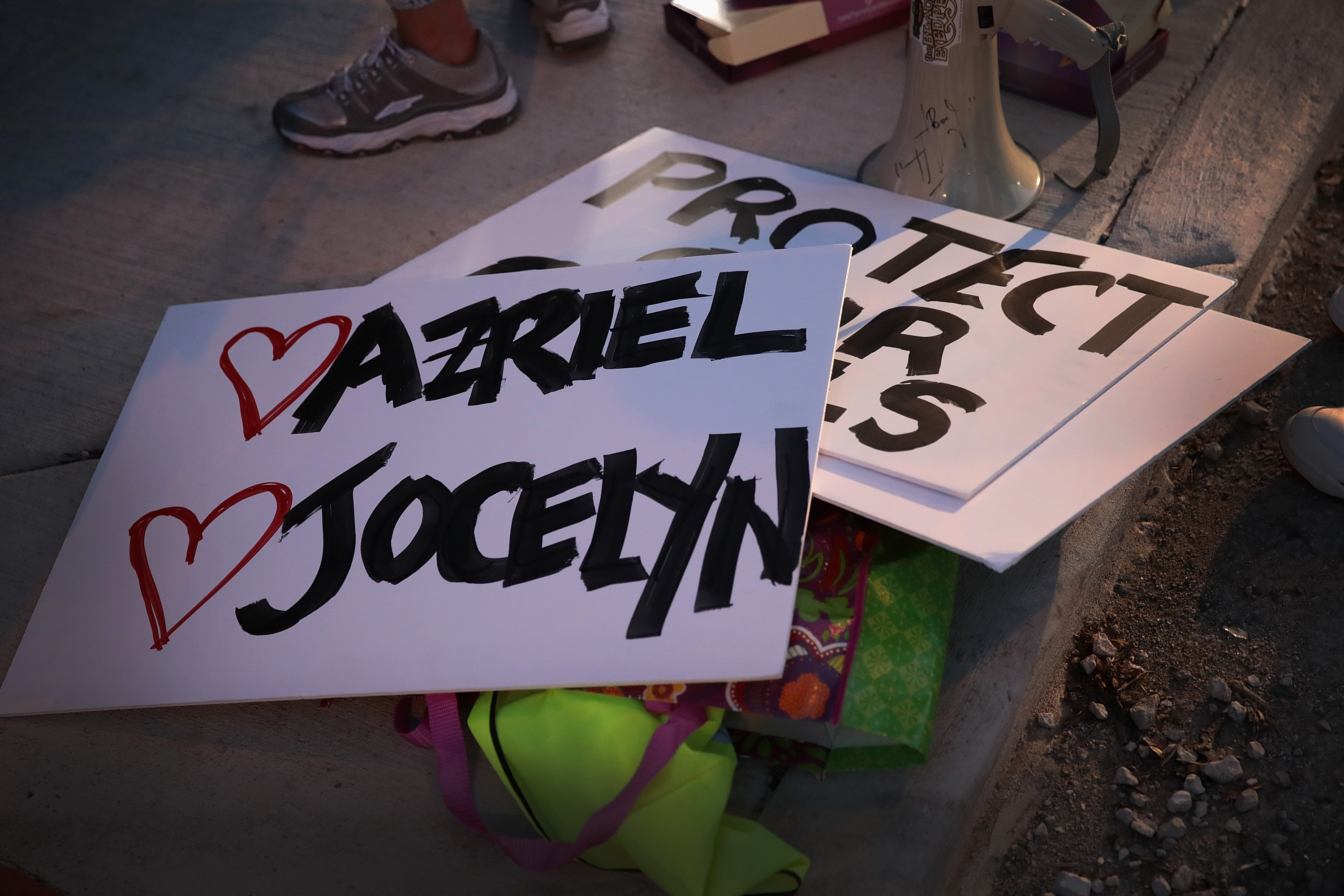 Signs bearing the names of alleged victims of singer R. Kelly lay on the ground before the start of a demonstration near his studio prompted by allegations of sexual abuse raised on Lifetime's mini-series 'Surviving R. Kelly.'