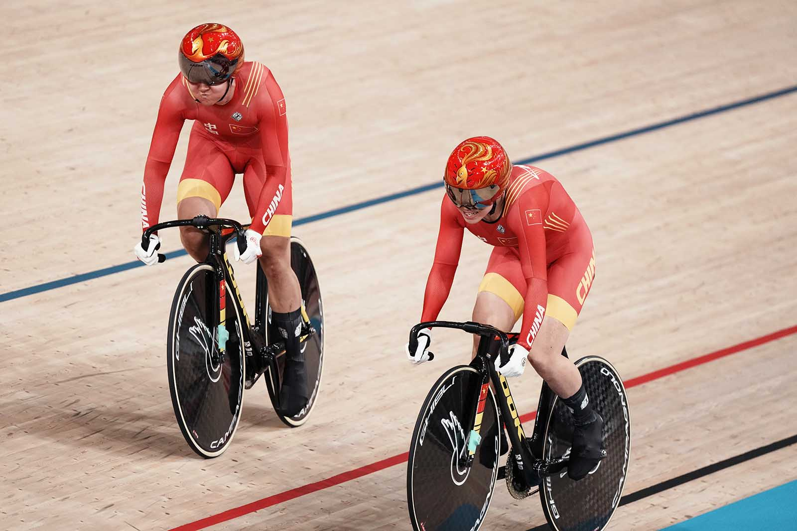 Zhong Tianshi and Bao Shanju of China compete during a qualifying heat for women's track cycling team sprint on Monday, August 2, in Izu, Japan.