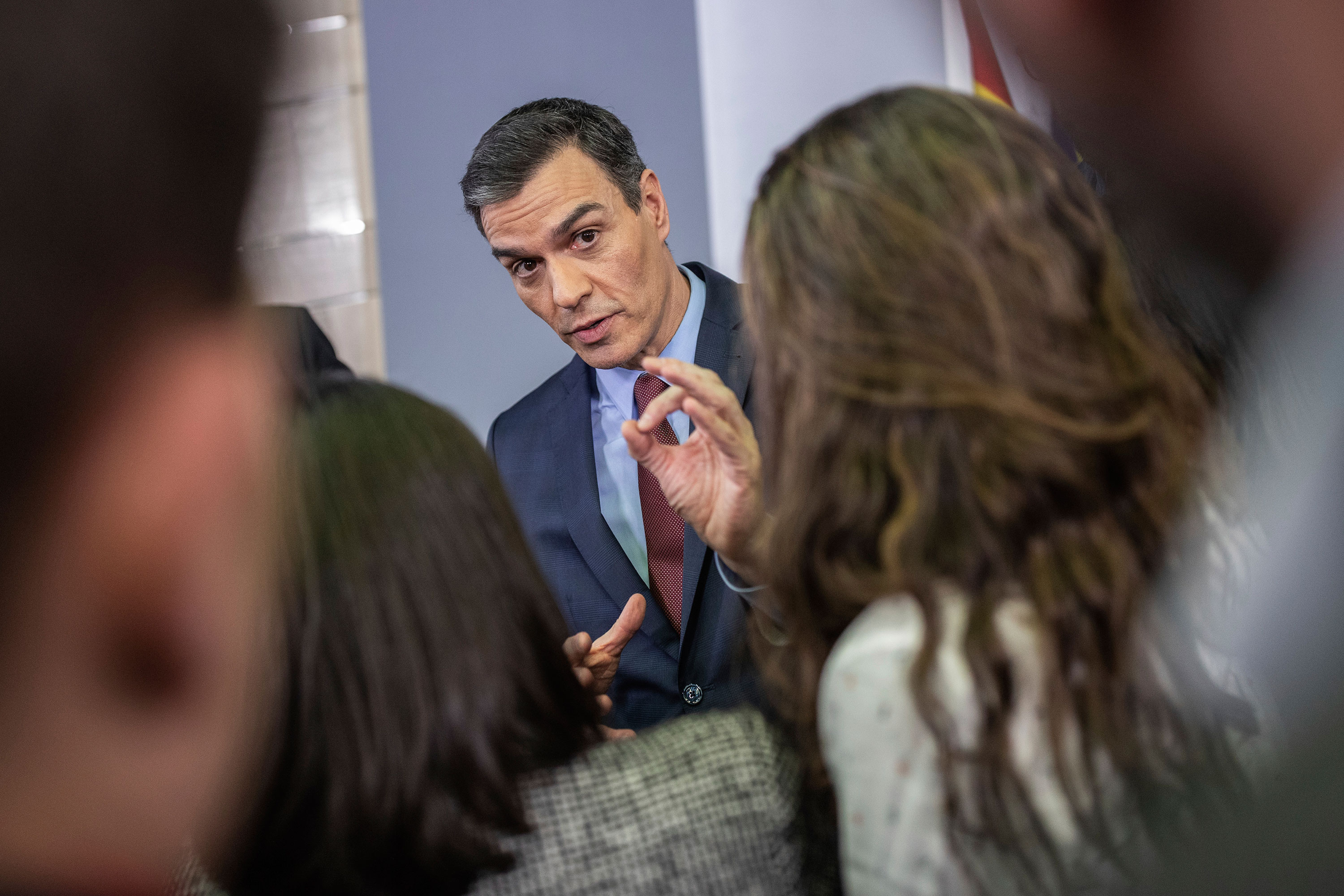 Spanish Prime Minister Pedro Sanchez talks to journalists after a coronavirus-related press conference at the Moncloa palace in Madrid, on March 10.