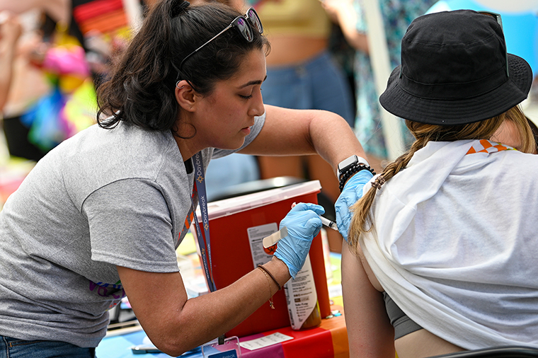A person gets the COVID-19 vaccine at the 2021 NYC Pride Fest near Union Square on June 27, in New York City.