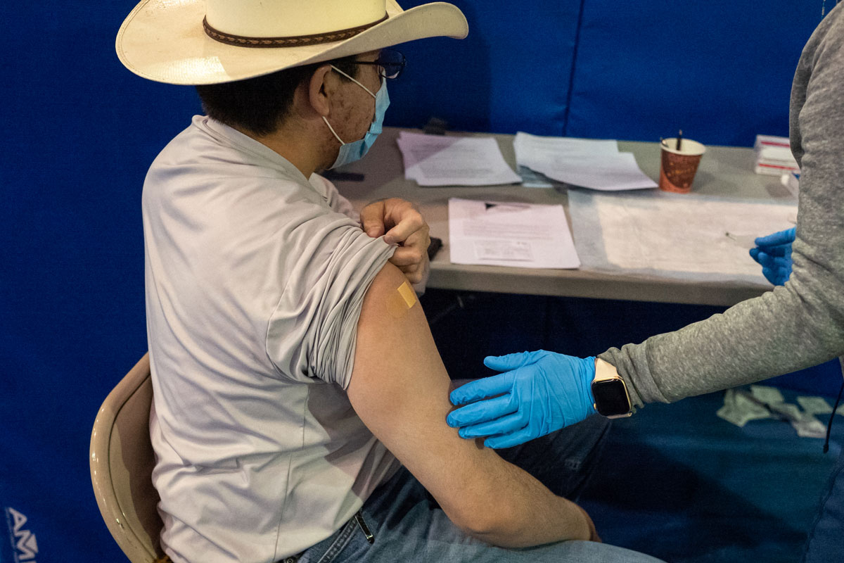 A person receives their second dose of the Pfizer-BioNTech vaccine in Gallup, New Mexico, on March 23.