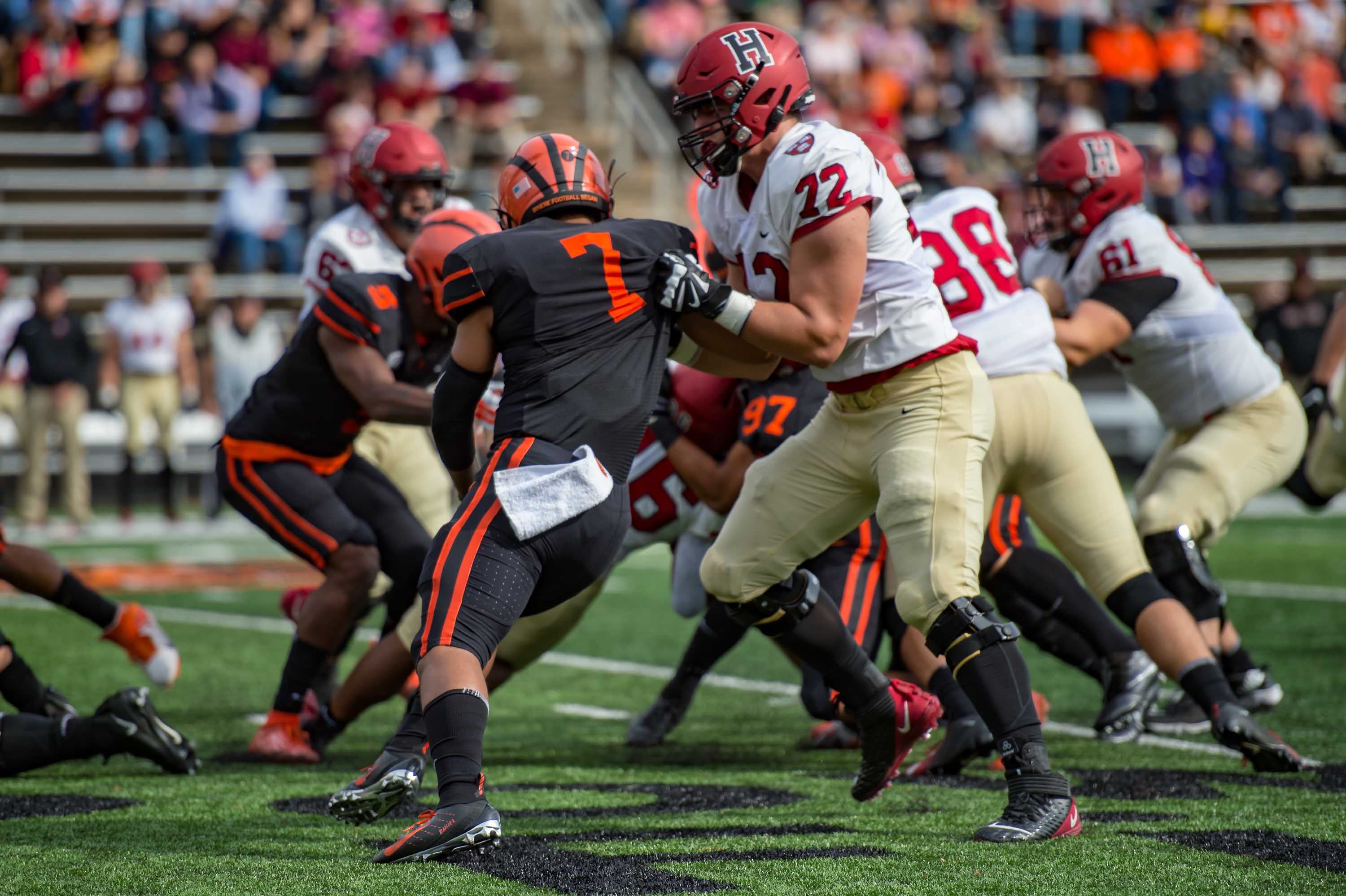 Harvard Crimson offensive lineman Spencer Rolland (72) blocks during a college football game between the Harvard Crimson and Princeton Tigers, at Princeton Stadium in New Jersey, in October 2019.