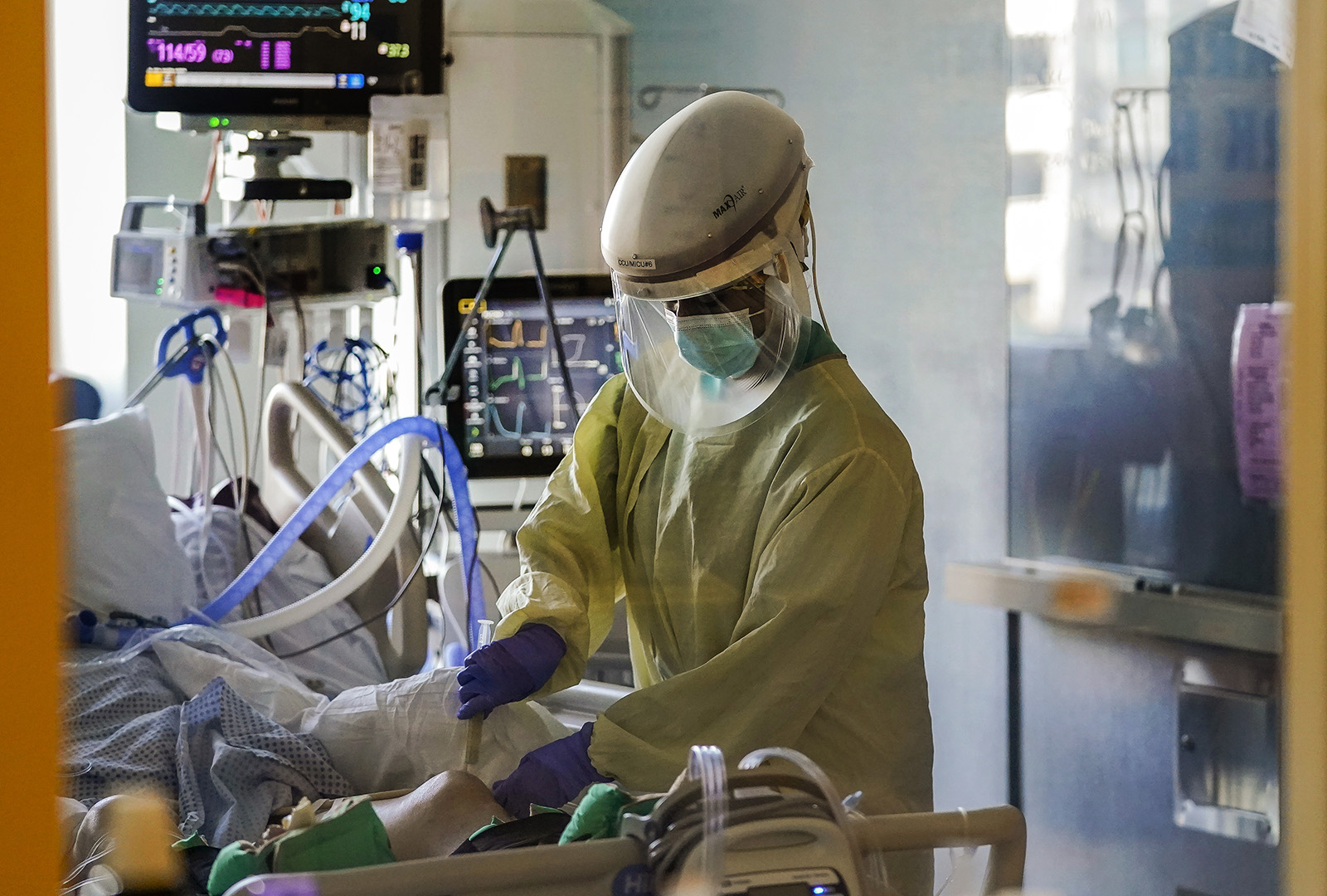 In this Wednesday, Jan. 13, 2021 file photo, a health care worker tends to a Covid-19 patient in the intensive care unit at Santa Clara Valley Medical Center during the coronavirus pandemic in San Jose, California.
