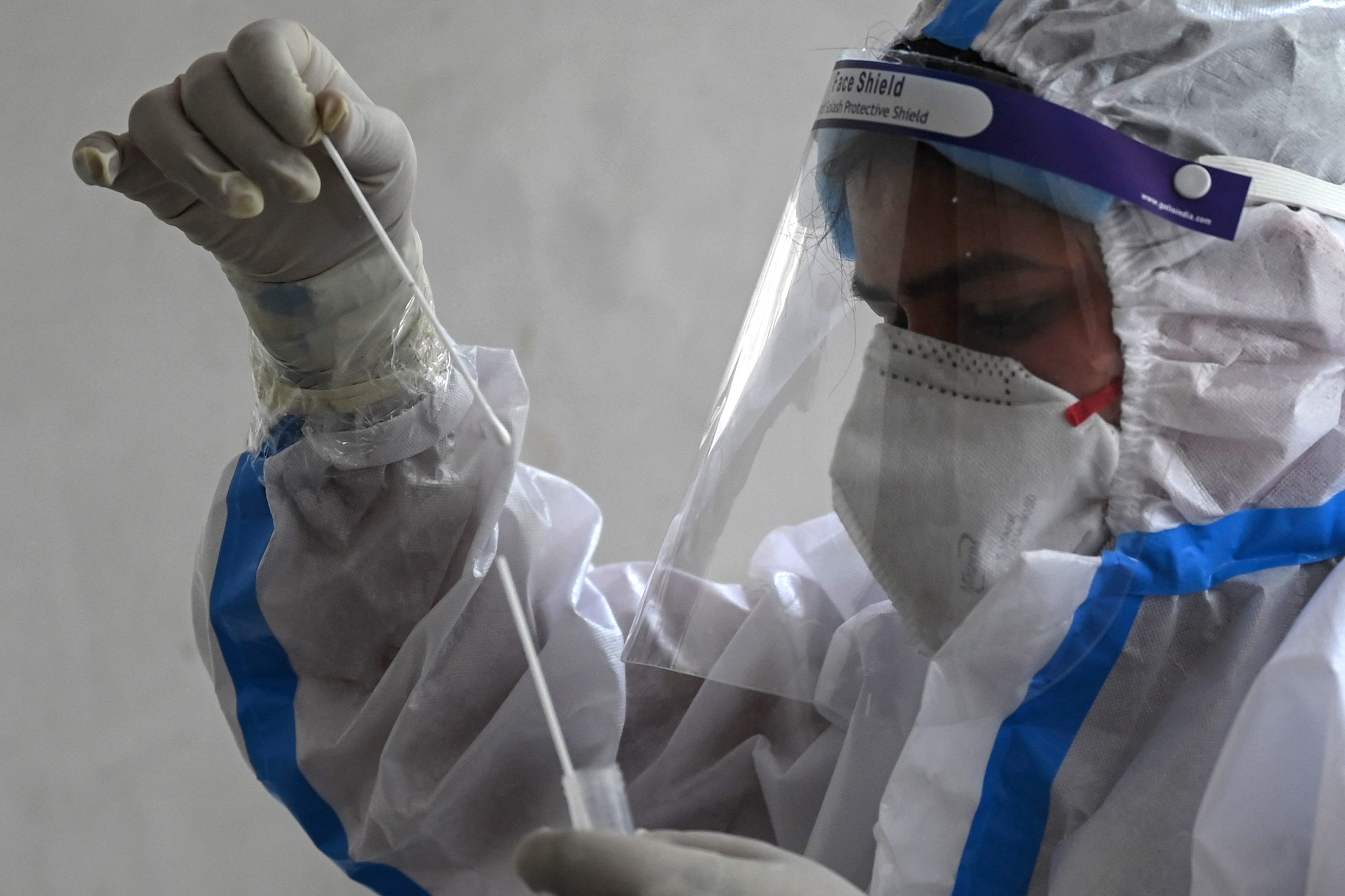 A health worker collects a swab sample for a Covid-19 test at a community center in New Delhi, India, on April 28.