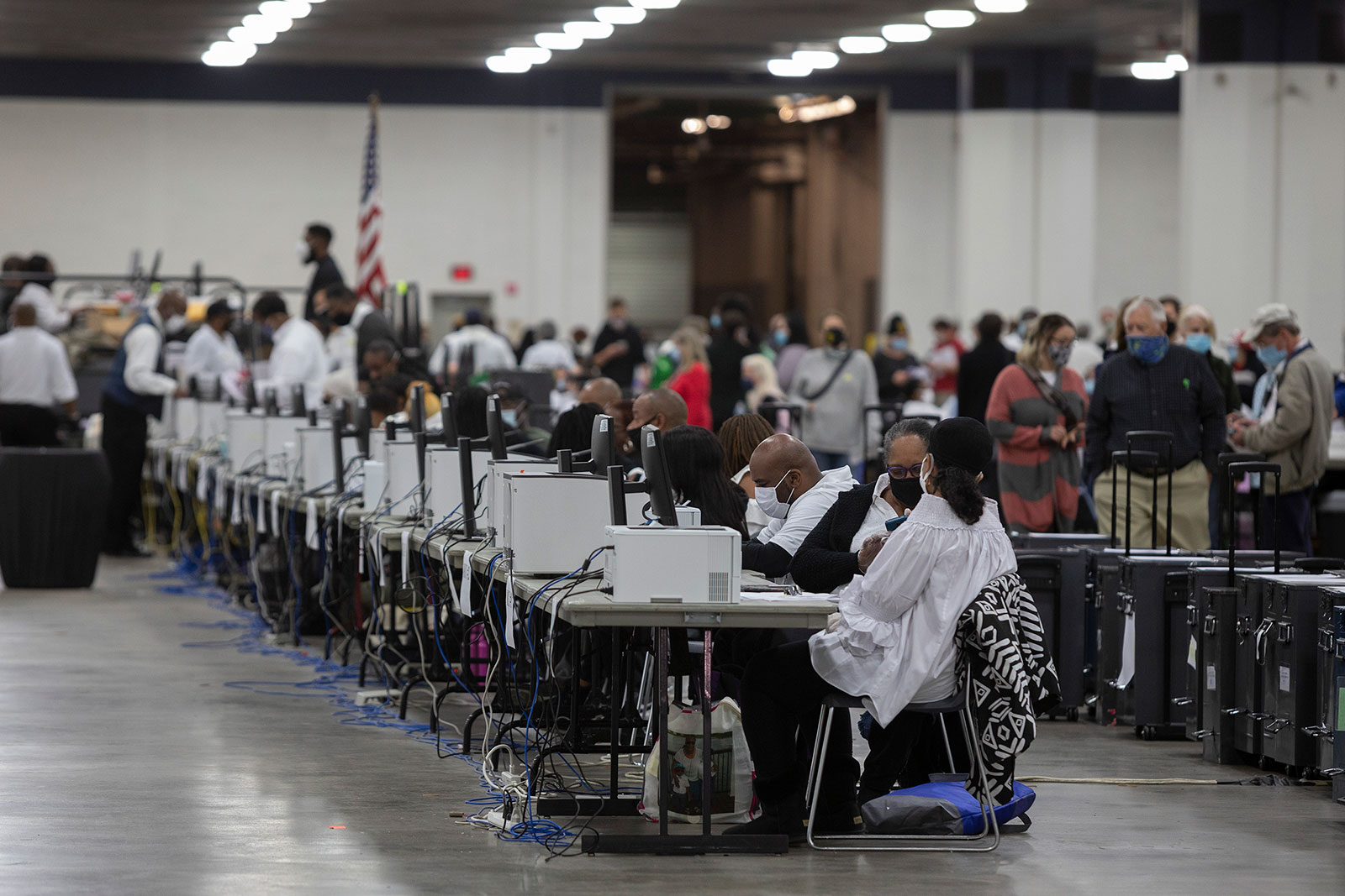 Workers with the Detroit Department of Elections help process absentee ballots at the Central Counting Board in the TCF Center in Detroit on November 4.