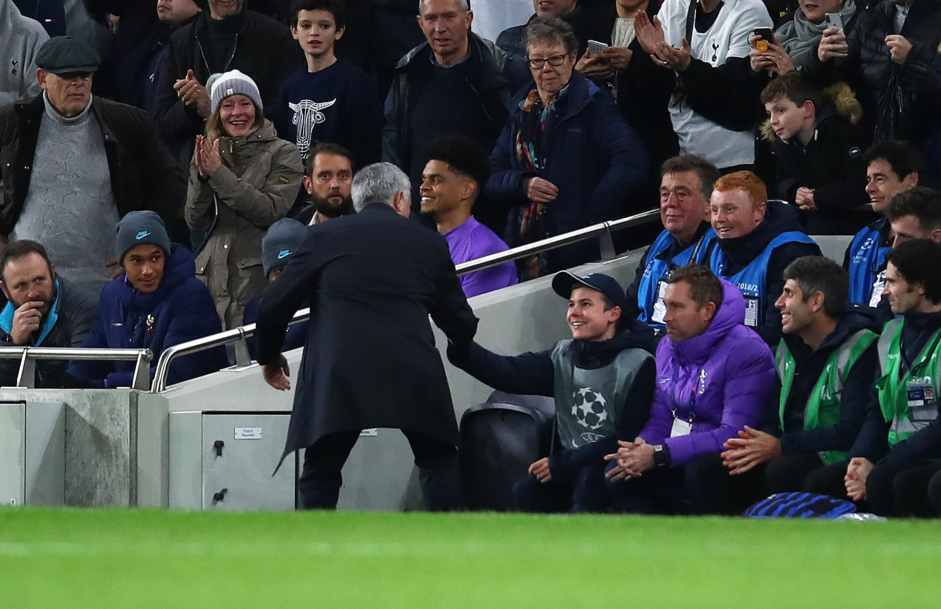 Spurs boss Jose Mourinho embraces the ball boy after his side drew level at 2-2