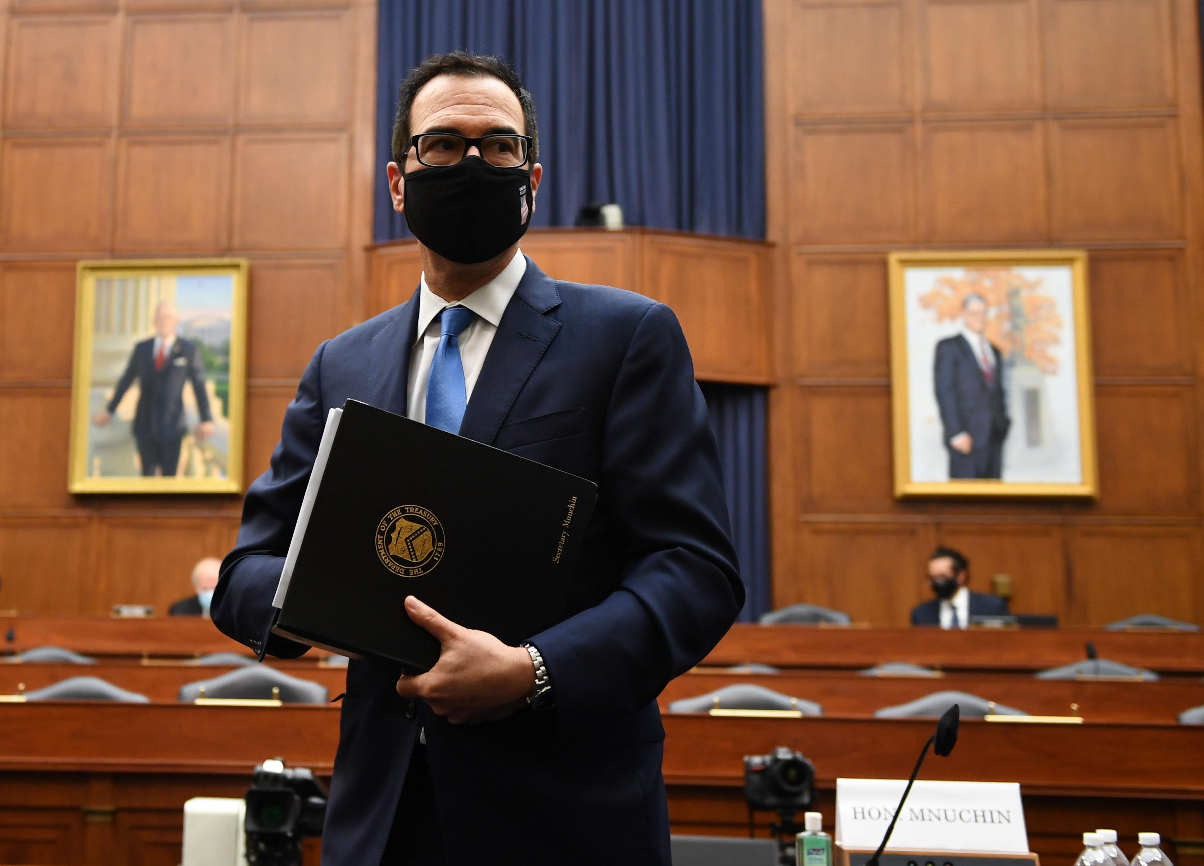 Treasury Secretary Steven Mnuchin stands after testifying in Washington, DC, on July 17.