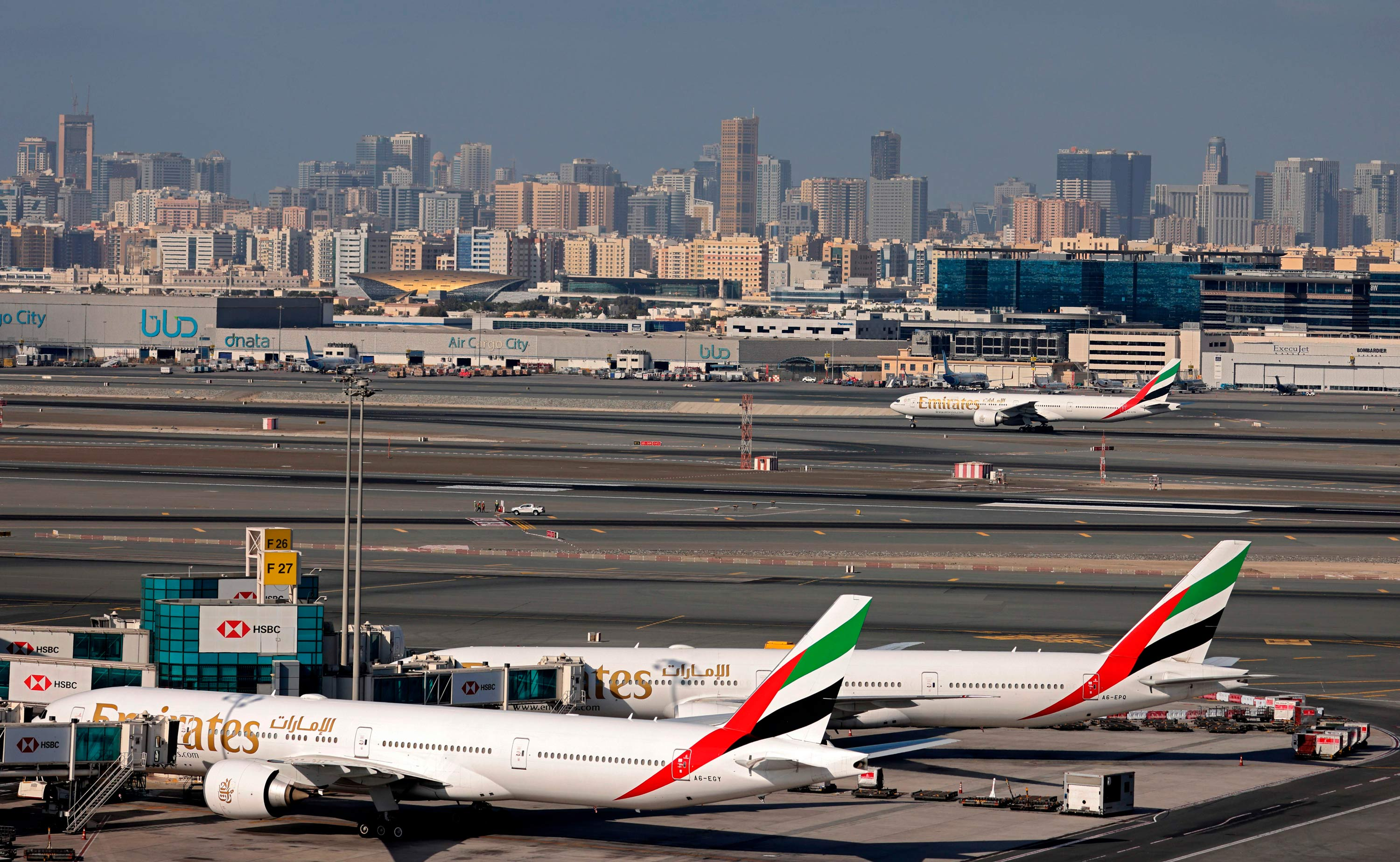 Emirates Airlines airplanes are seen at Dubai International Airport on February 1.