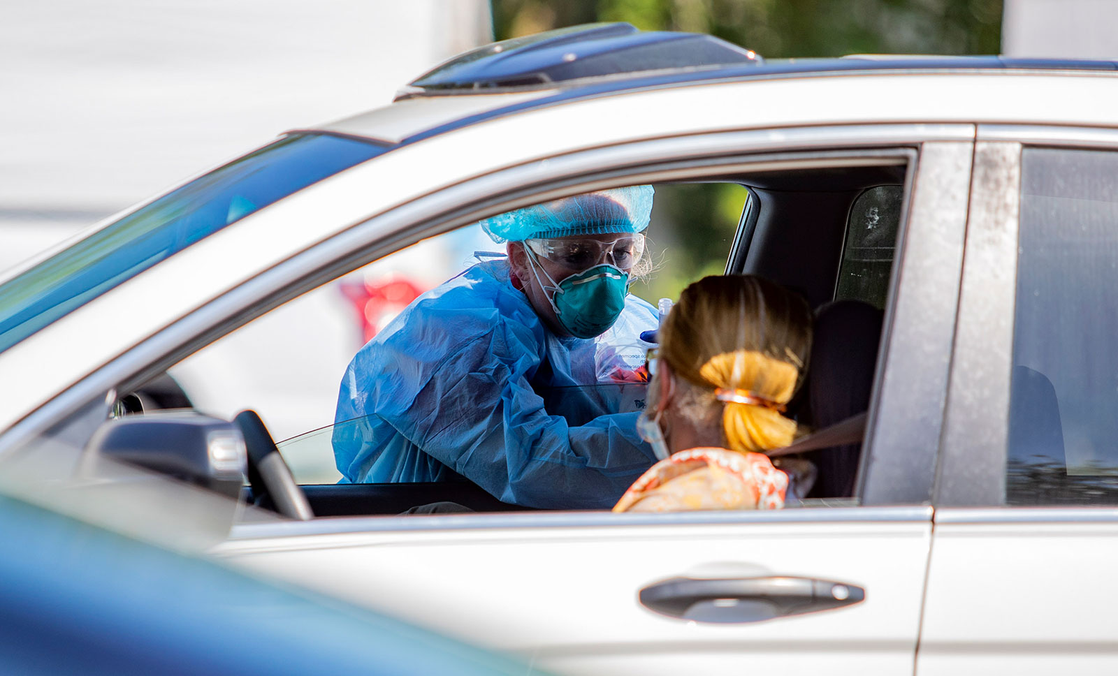 A healthcare worker administers a coronavirus test at a drive-thru testing center in Myrtle Beach, South Carolina, on July 17.