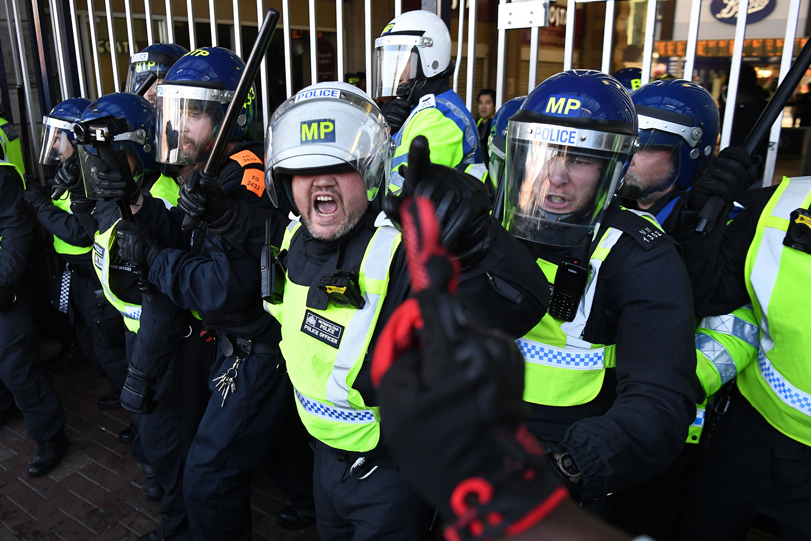 Police prevent people entering Waterloo Station after protesters supporting the Black Lives Matter movement clash with opponents in central London on June 13.