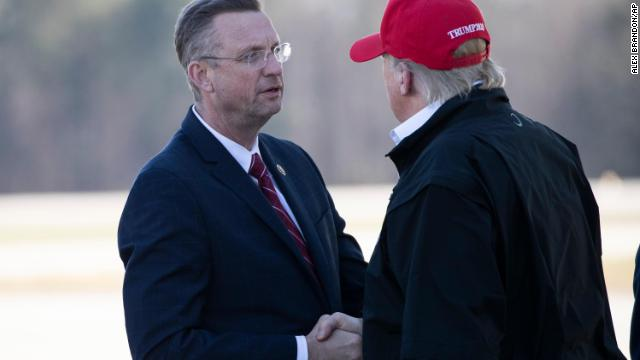 Rep. Doug Collins greets President Trump as he steps off Air Force One during arrival on March 6 at Dobbins Air Reserve Base in Marietta, Georgia.