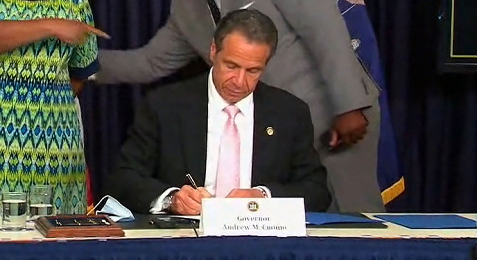 New York Gov. Andrew Cuomo signs police reform bills at a news conference on June 12.