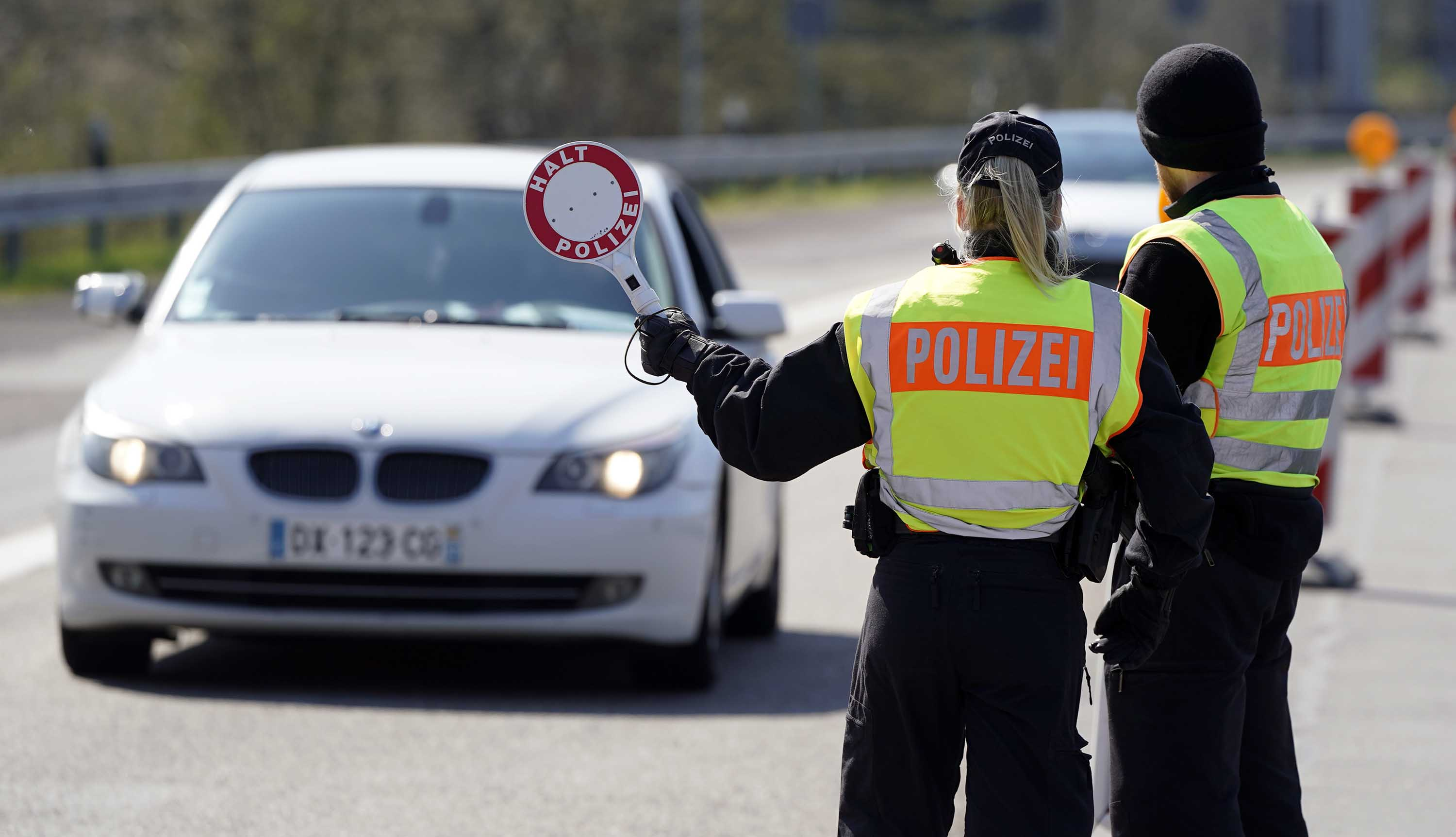 German Federal police officers control vehicles at the border to France in Saarbruecken, Germany, on March 26.