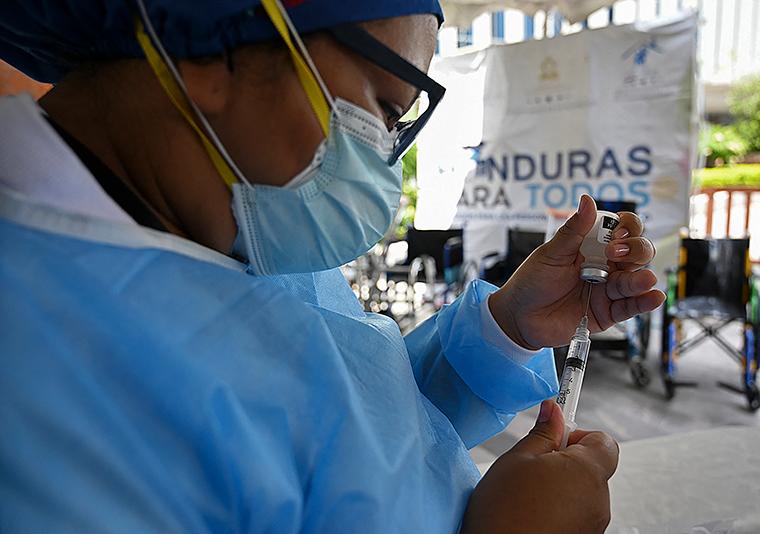 A nurse of the Health Secretariat prepares a Pfizer vaccine against COVID-19 at the Jose Cecilio del Valle civic centre in Tegucigalpa, Honduras, on June 2