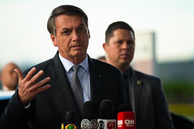 Brazilian President Jair Bolsonaro speaks with press on Tuesday March, 17,  in Brasilia, Brazil.