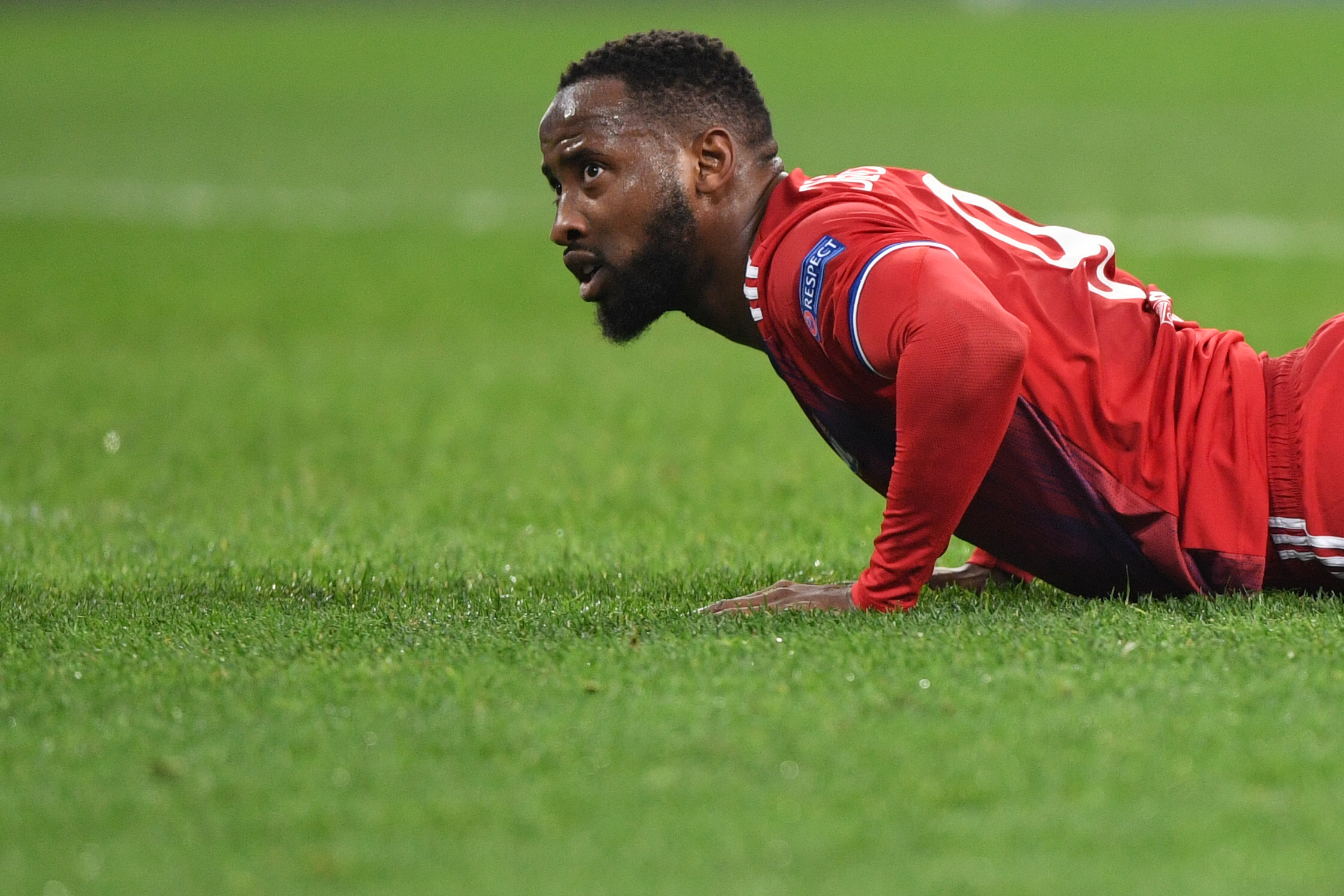 Lyon's French forward Moussa Dembele lies on the pitch during the UEFA Champions League group G football match between Zenit and Lyon at the Gazprom Arena in Saint Petersburg on November 27, 2019.