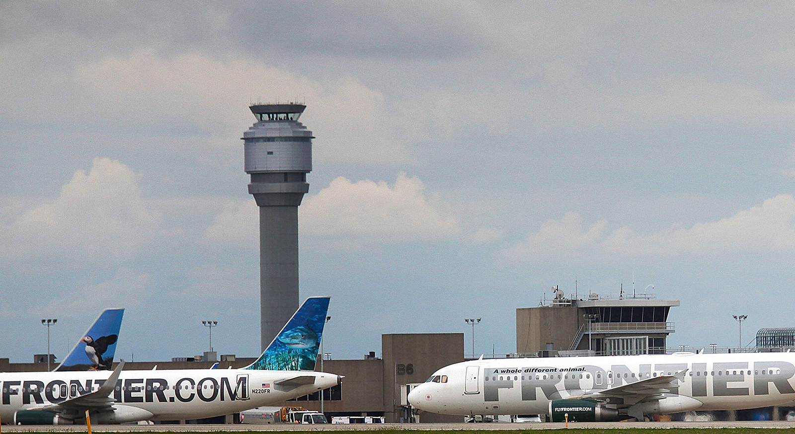 A Frontier Airlines plane taxis the runway at Cleveland Hopkins Airport on October 15, 2014 in Cleveland, Ohio.