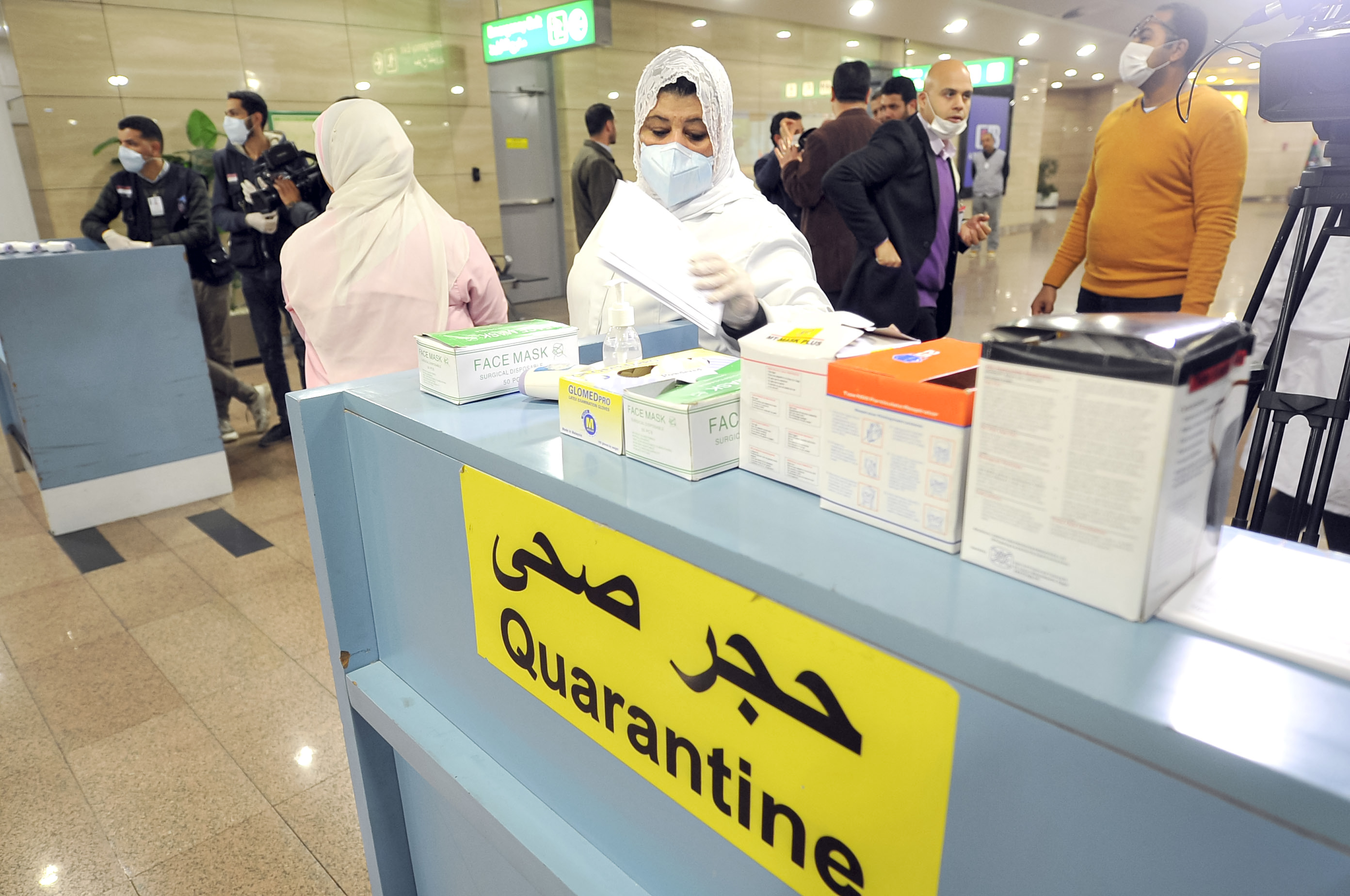 Egyptian Quarantine Authority employees scan incoming travellers at Cairo International Airport on February 1.