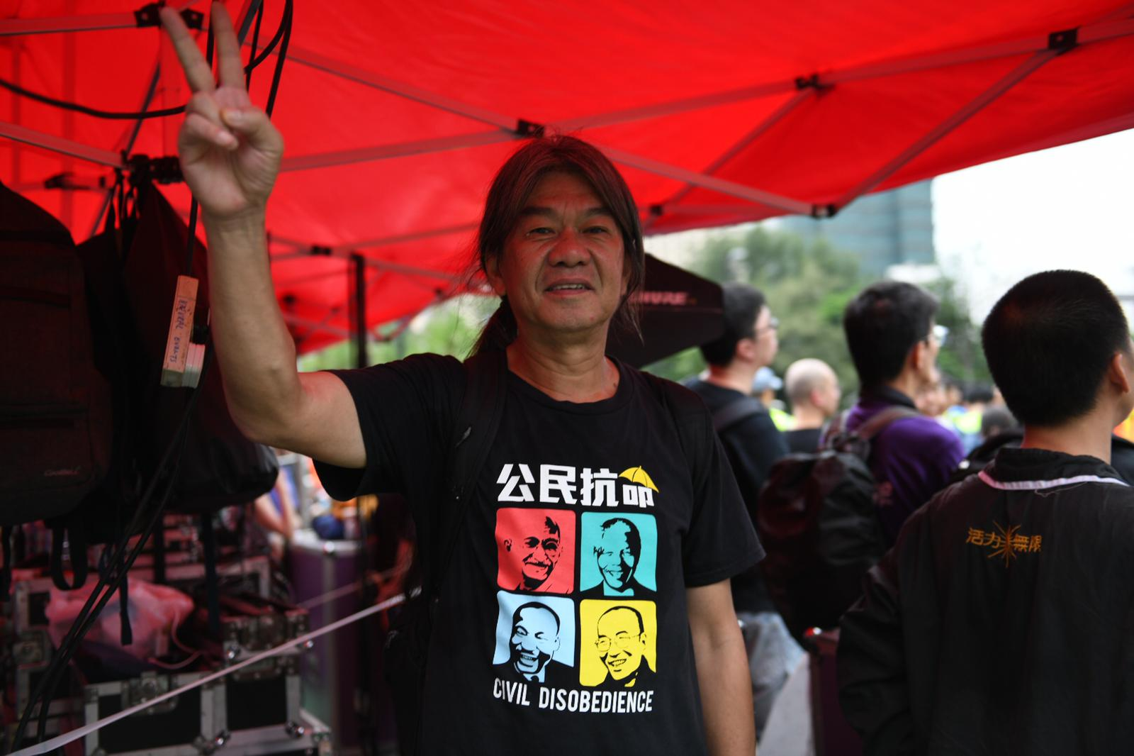 "Lawmaker Leung Kwok-hung, or ""Long Hair,"" in Victoria Park on Sunday."