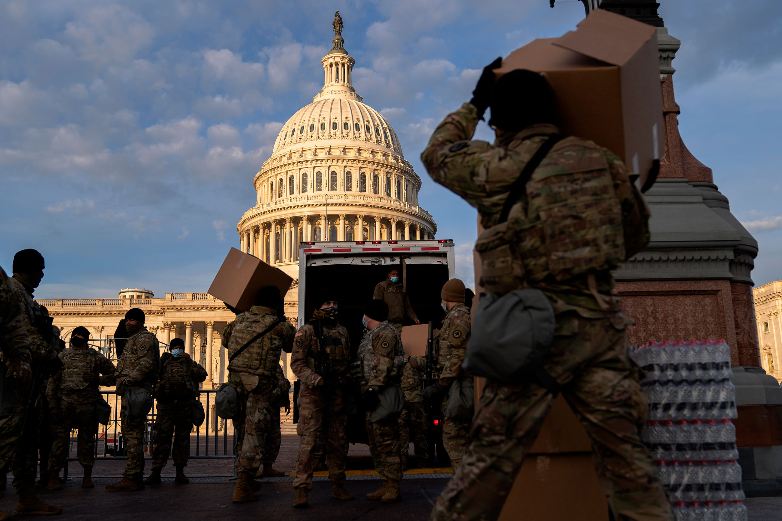 National Guard members unload supplies outside the US Capitol on January 14, in Washington, DC.