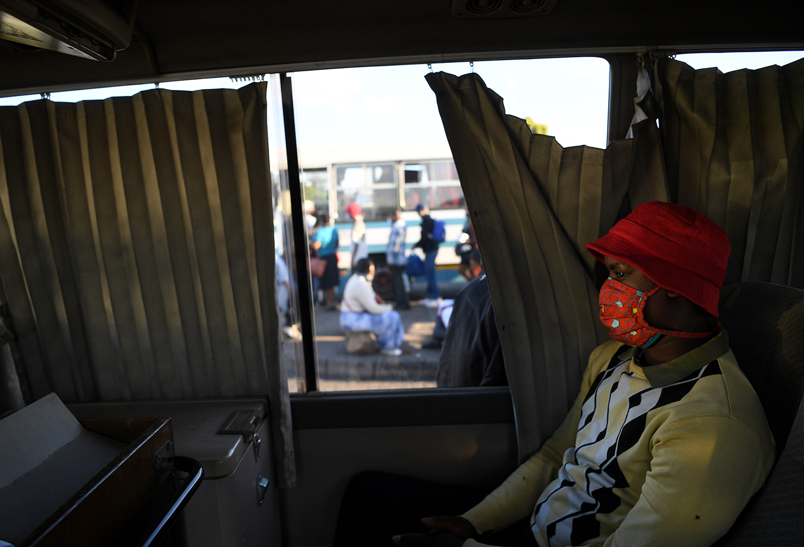 A commuter wears a face mask on a bus in Gaborone, Botswana on May 21.
