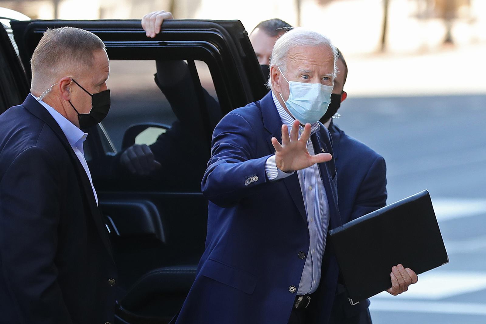 Joe Biden waves to journalists on October 3 in Wilmington, Delaware.