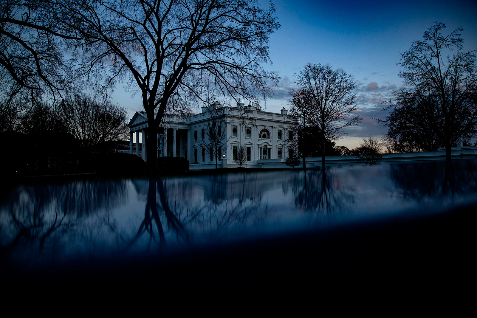 The sun sets over the White House in Washington, DC on December 21.