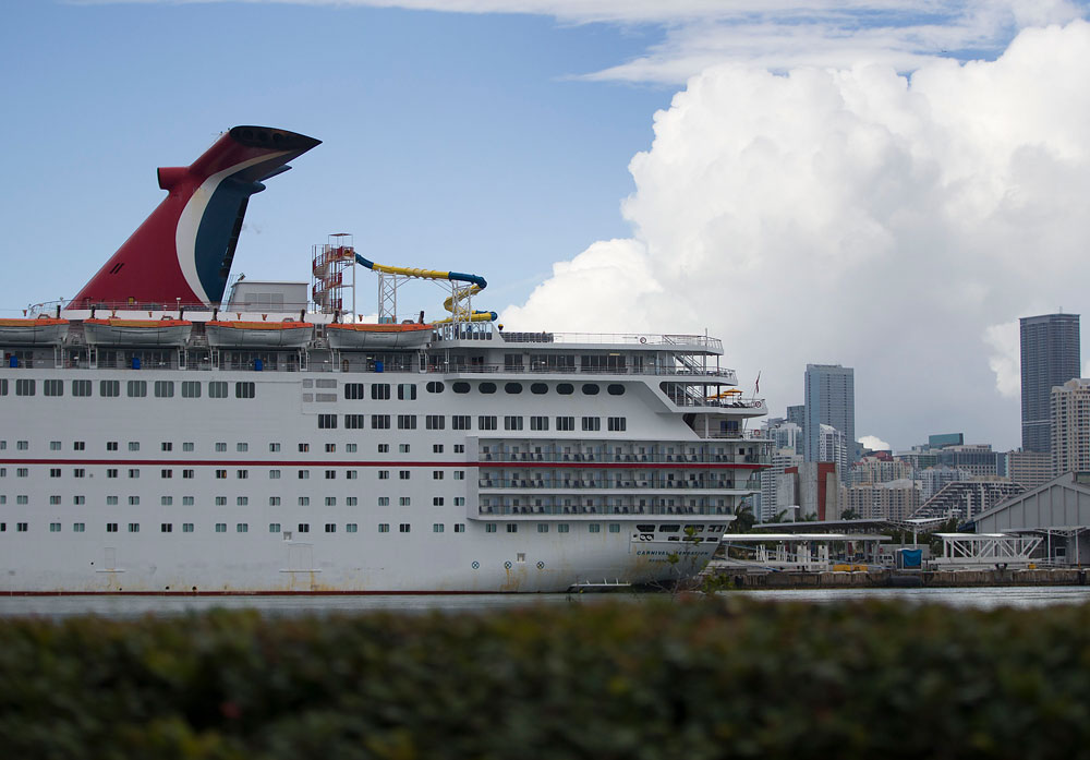 In this May 2, 2019 file photo, a Carnival Cruise ship is docked at the PortMiami in Florida.