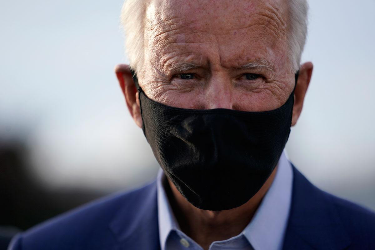 Joe Biden speaks to members of the media before boarding a plane at Charlotte Douglas International Airport in Charlotte, N.C., Wednesday, Sept. 23.