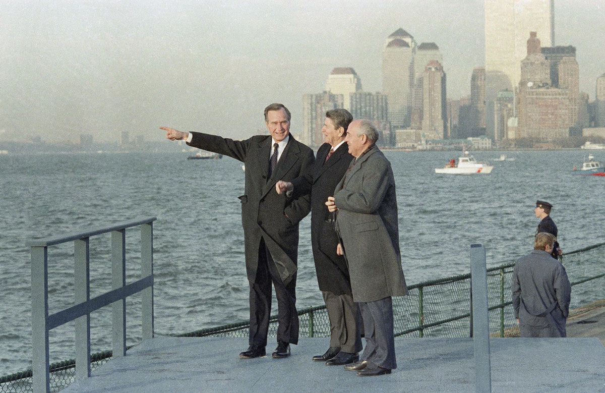 US President-elect George H.W. Bush points out sights for Gorbachev while Reagan looks on, as they overlook New York Harbor from Governors Island in 1988.