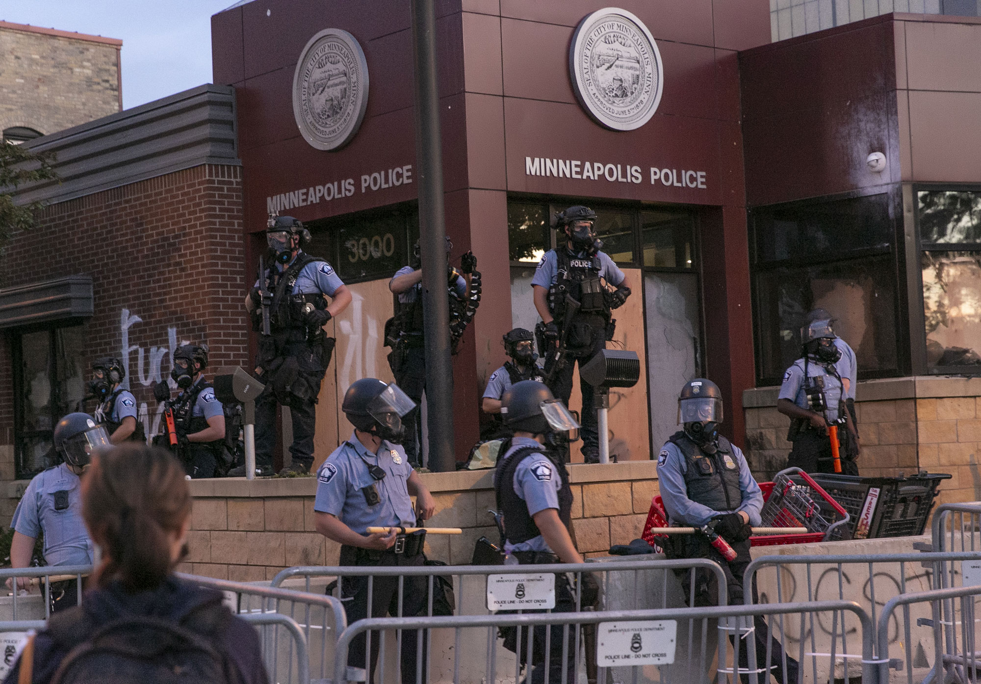 Police stand guard at the 3rd precinct on May 27 during the second day of protests over the death of George Floyd in Minneapolis.