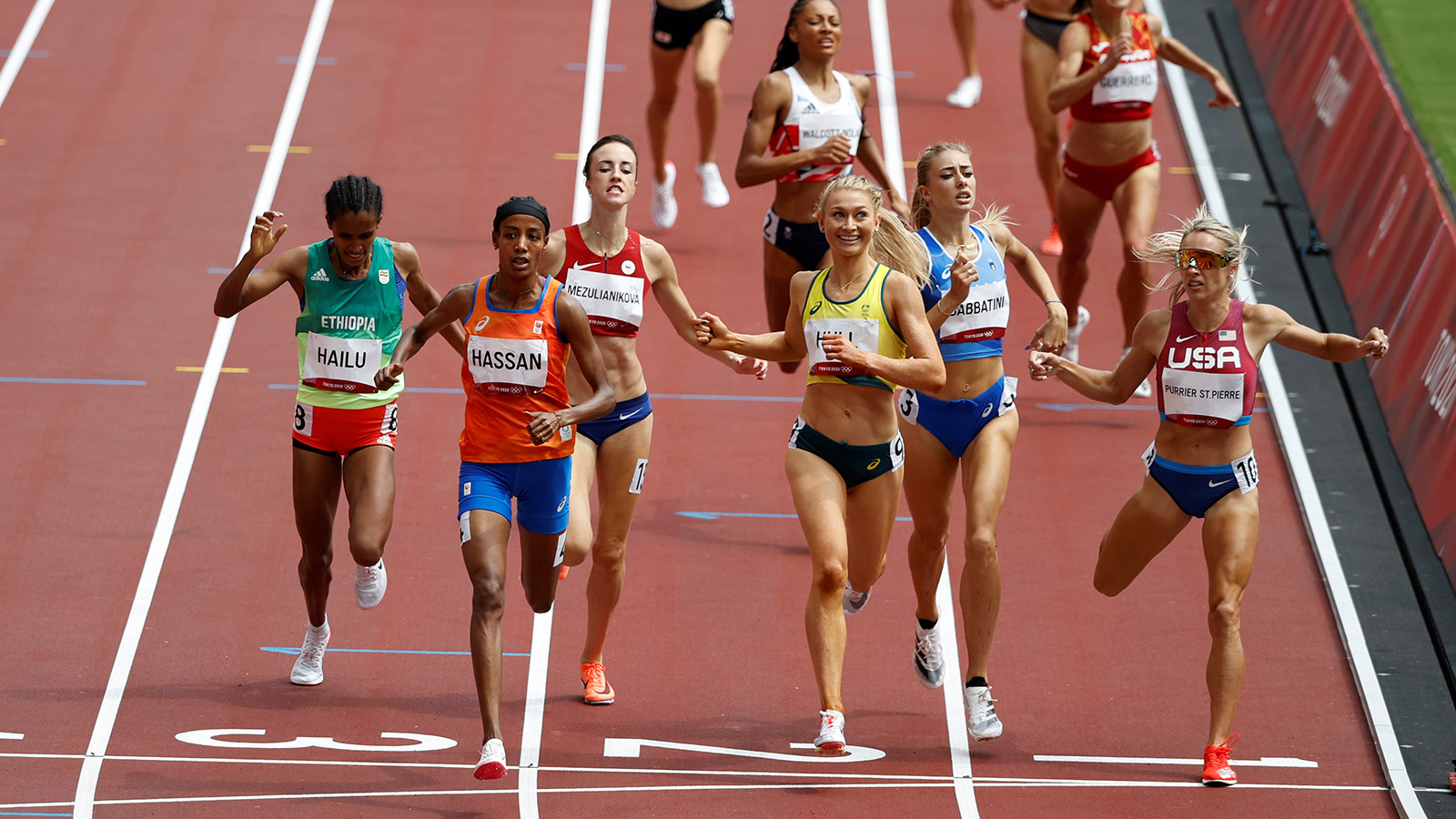 Sifan Hassan crosses the line to finish firstduring a 1500 meter heat on Monday.