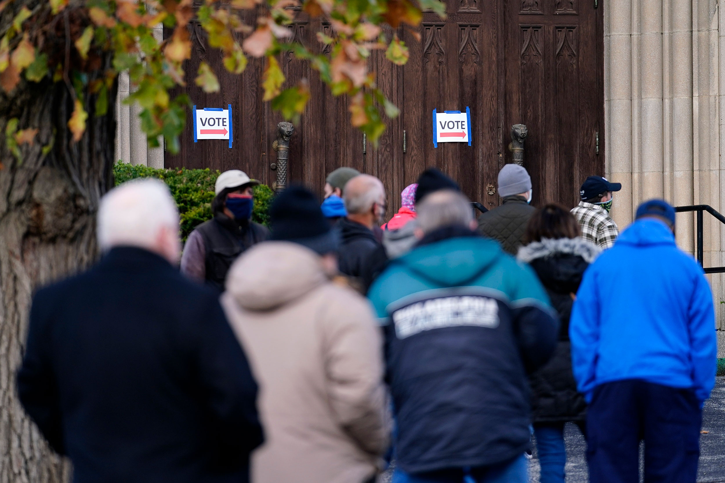 People wait outside a polling place to cast their ballots on November 3 in Media, Pennsylvania.