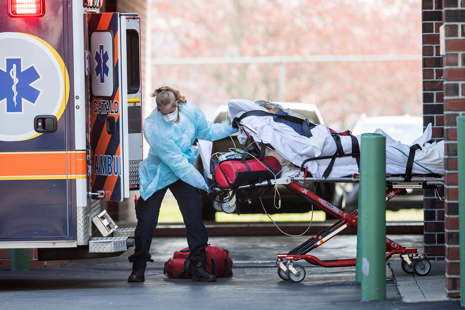 First responders load a patient into an ambulance from a nursing home where multiple people have contracted Covid-19 on April 17 in Chelsea, Massachusetts.