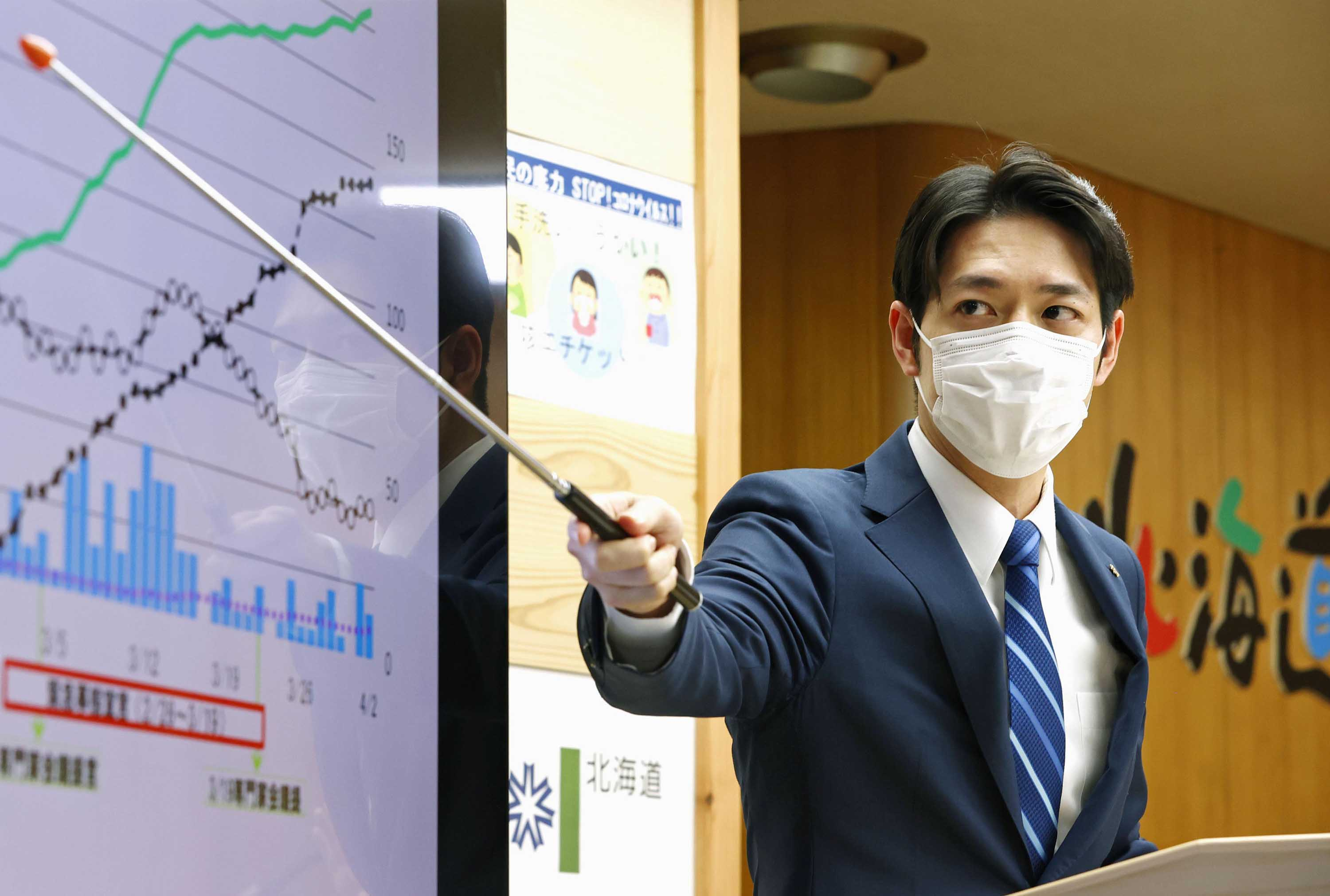 Hokkaido Governor Naomichi Suzuki holds a press conference at his office on April 2.