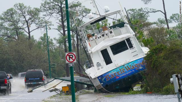 A boat is washed up near a road after the storm moved through Orange Beach, Alabama, on Sept. 16.