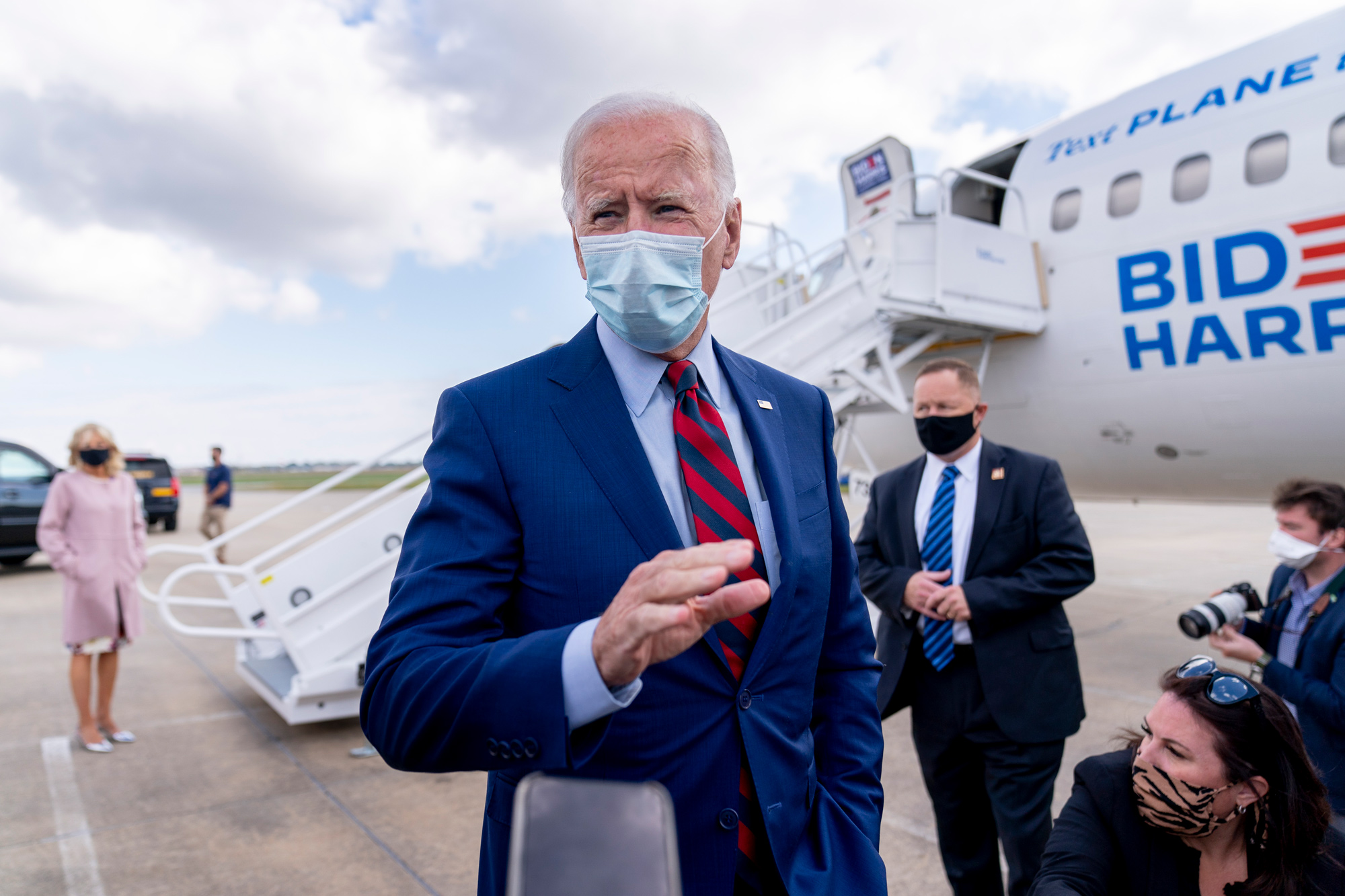 Democratic presidential candidate Joe Biden speaks to members of the media before boarding his campaign plane at New Castle Airport in New Castle, Delaware, on October 5.