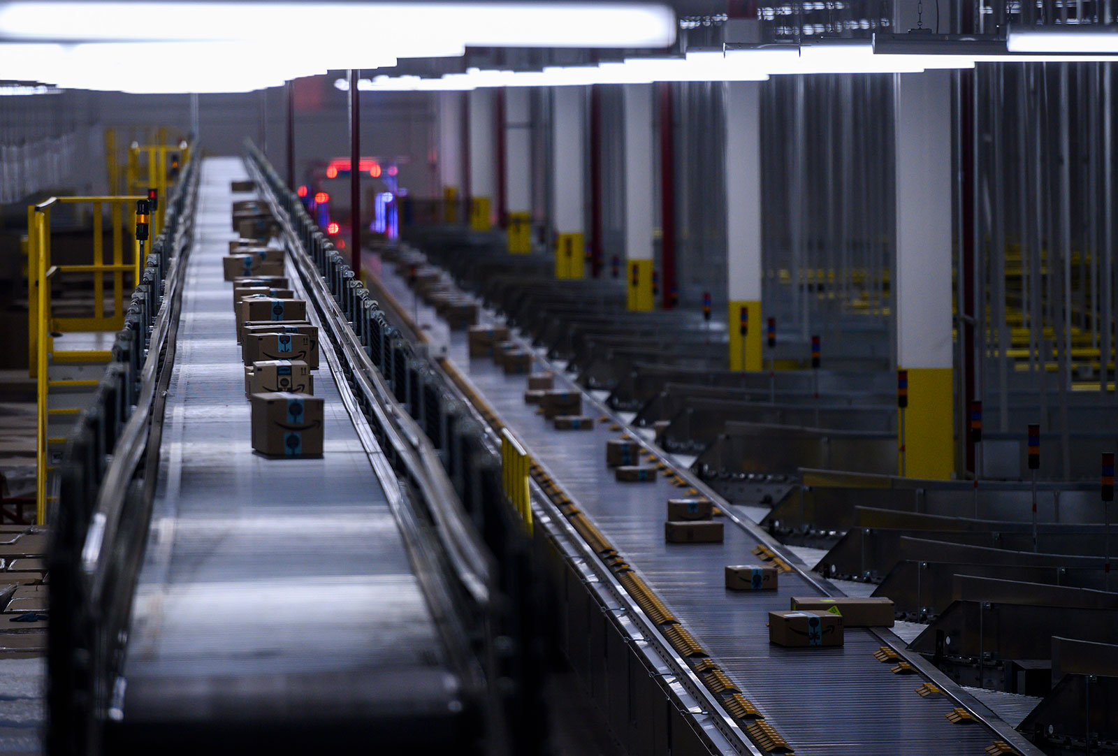 Orders move down a conveyor belt at the Amazon fulfillment center in Staten Island, New York. On Tuesday the company confirmed the death of an employee who worked at the facility.