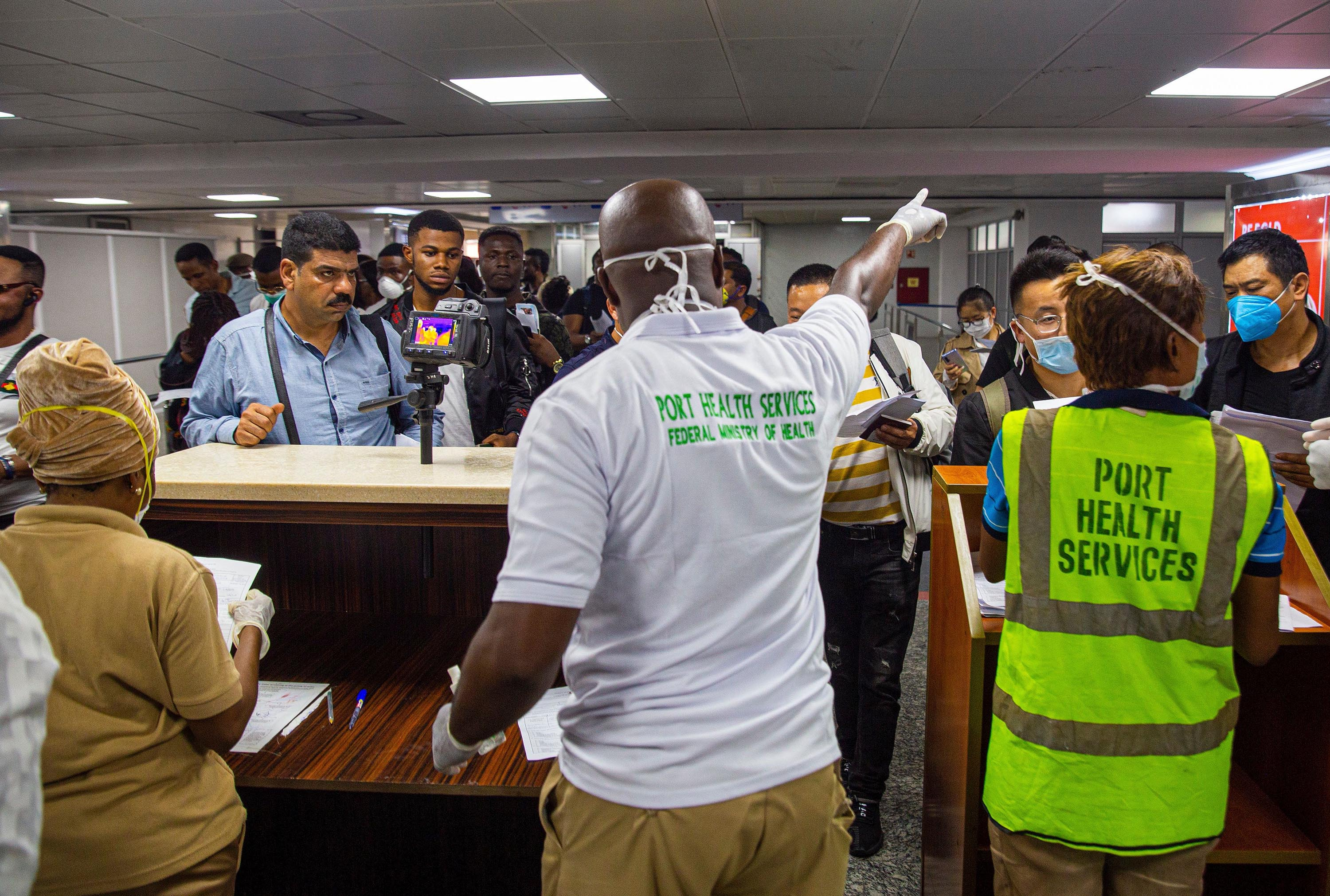 Health officials screen passengers at Murtala International Airport in Lagos, Nigeria, on March 2.