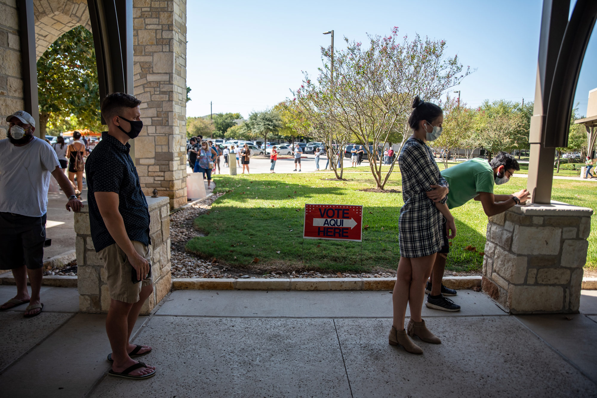 Voters wait in line at a polling location on October 13 in Austin, Texas.