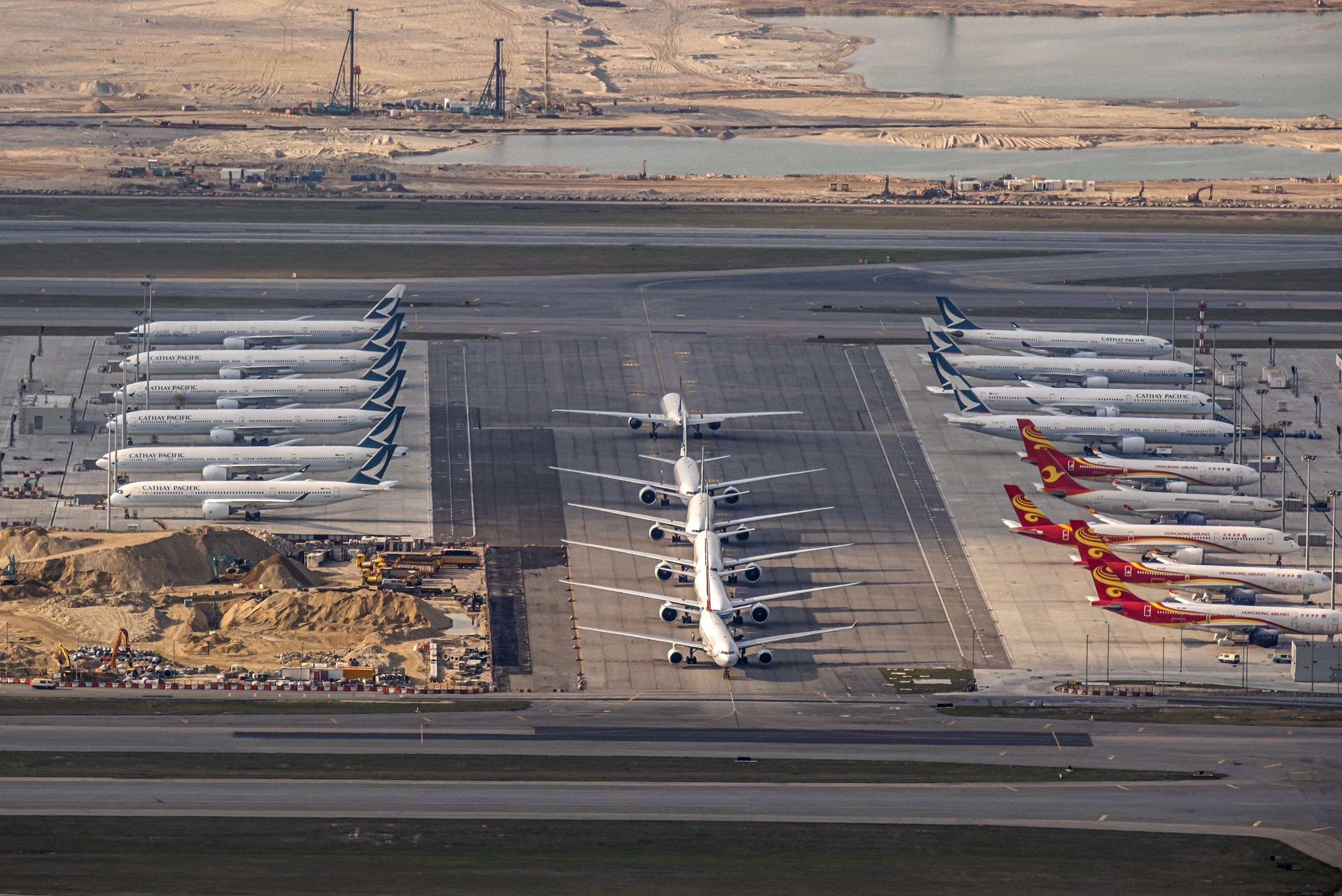 Aircraft operated by Cathay Pacific and Hong Kong Airlines sit parked on the tarmac at Hong Kong International Airport on March 5.