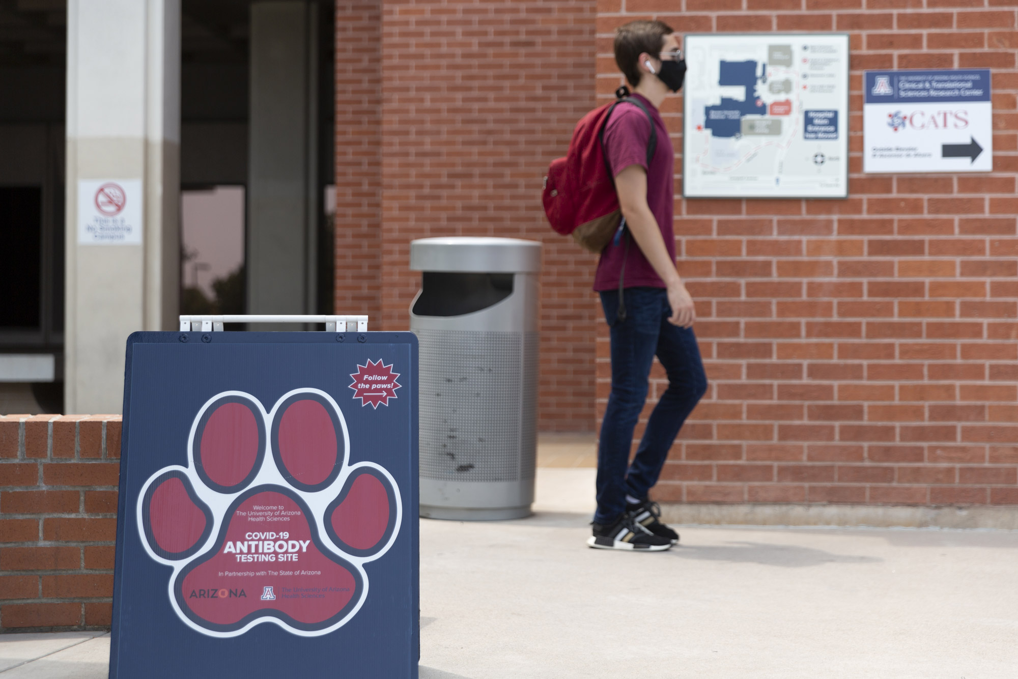 A person passes a Covid-19 antibody testing sign at the University of Arizona in Tucson, Arizona, on August 24.