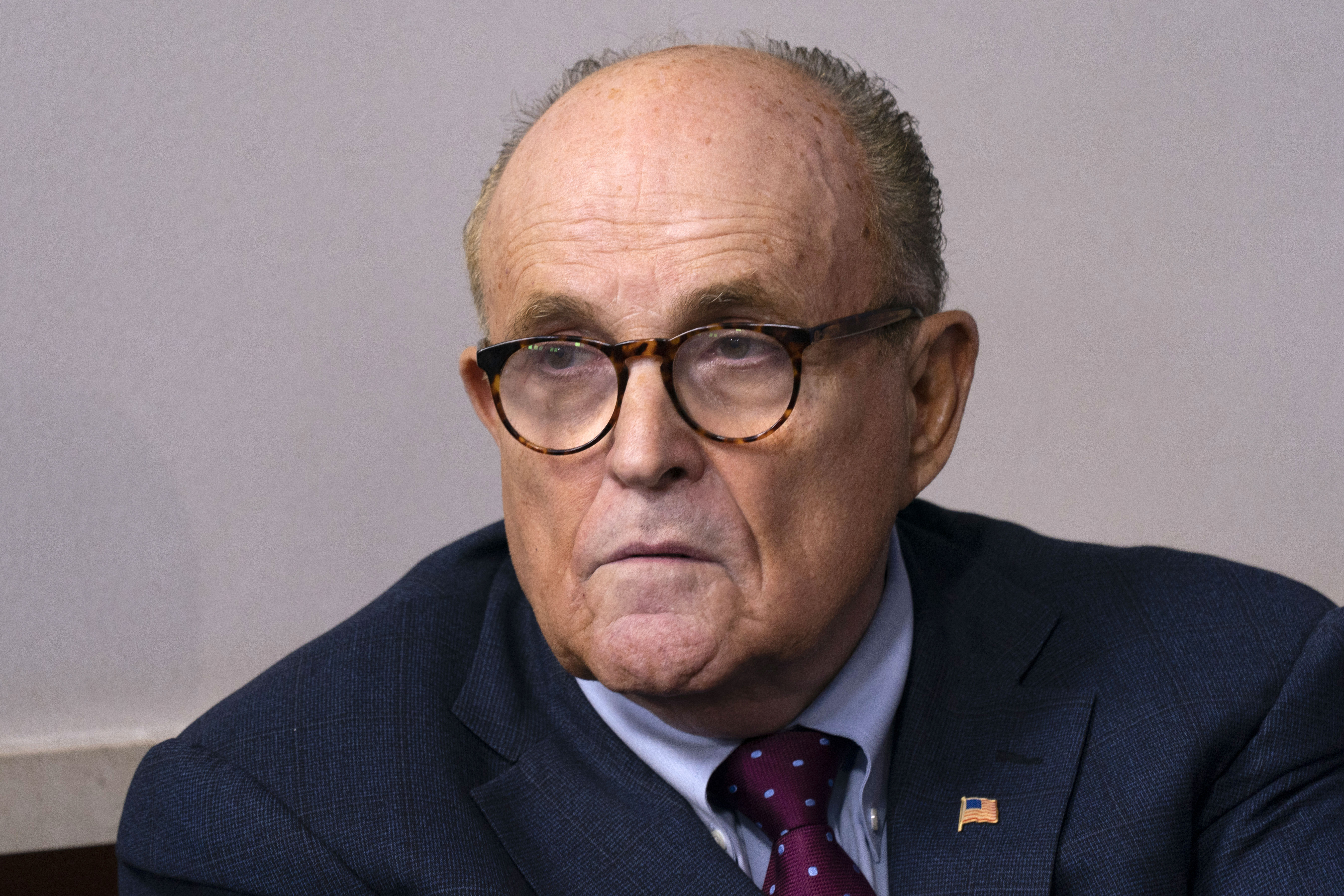 Rudy Giuliani listens during a news conference at the White House on September 27.