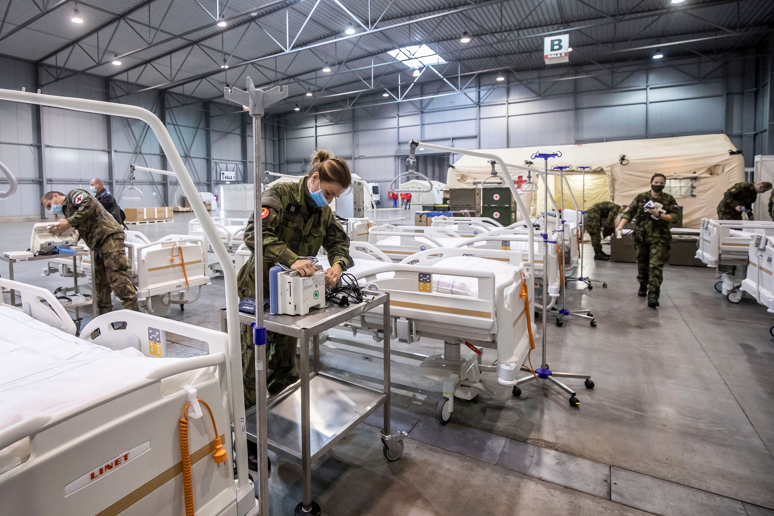 Members of the Czech Army set up equipment and beds inside a field hospital for Covid-19 patients on October 22 in Prague, Czech Republic.