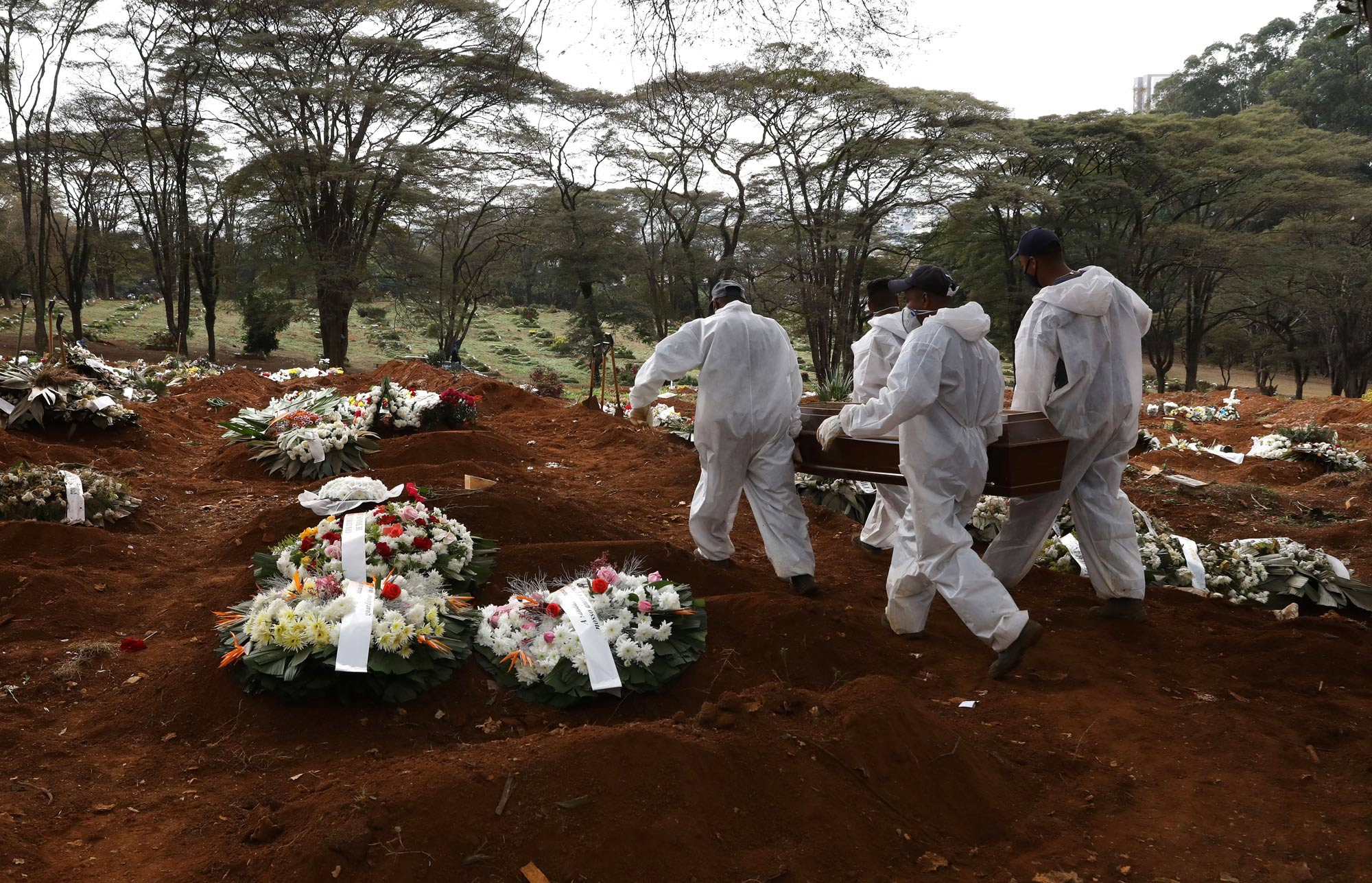Cemetery workers carry the coffin of a COVID-19 victim to be buried at Vila Formosa cemetery on June 17 in Sao Paulo, Brazil.