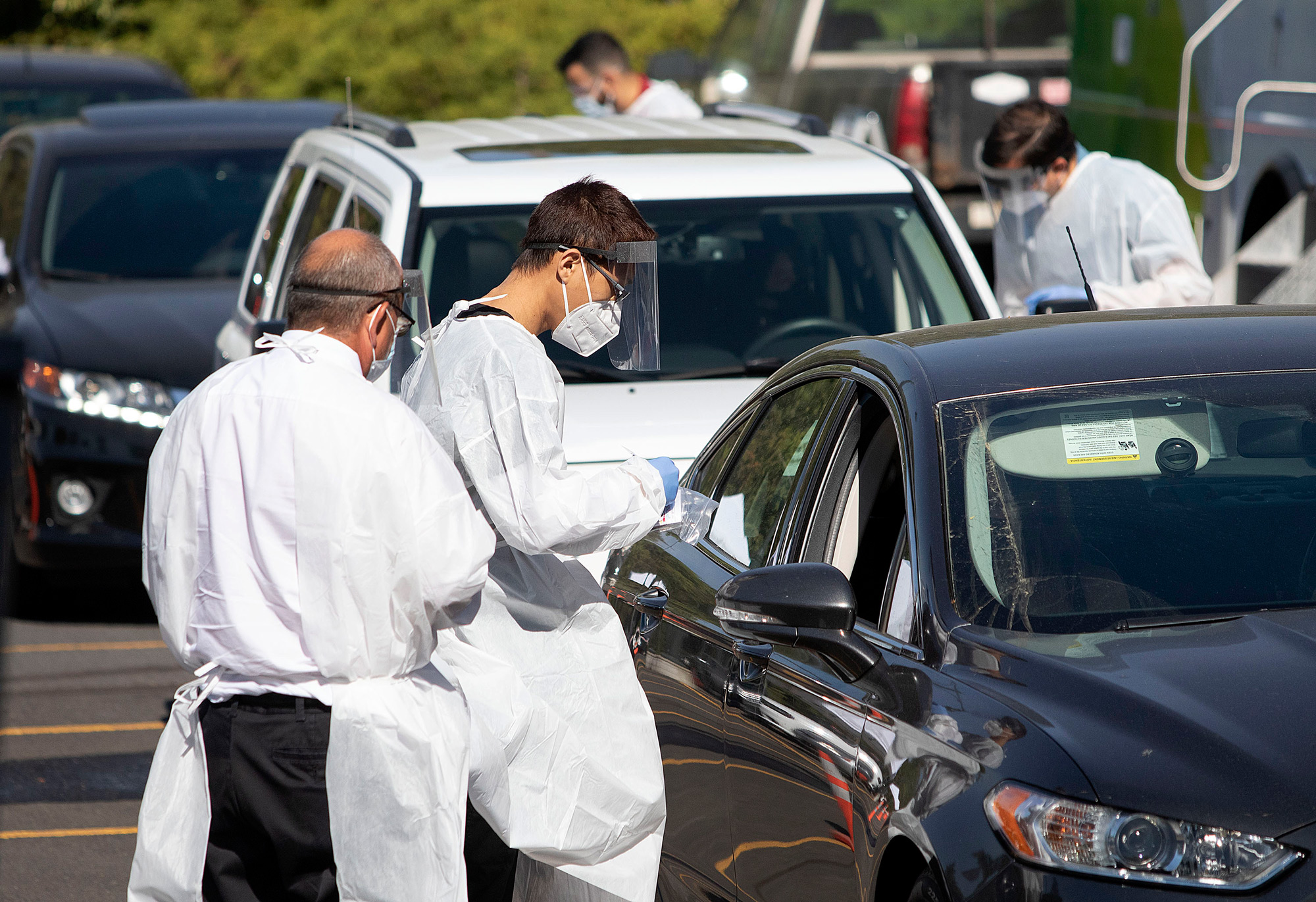 Faculty members from Washington State University Health Sciences Spokane administer COVID-19 tests to students at a mobile testing site on campus on September 2 in Pullman, Washington.
