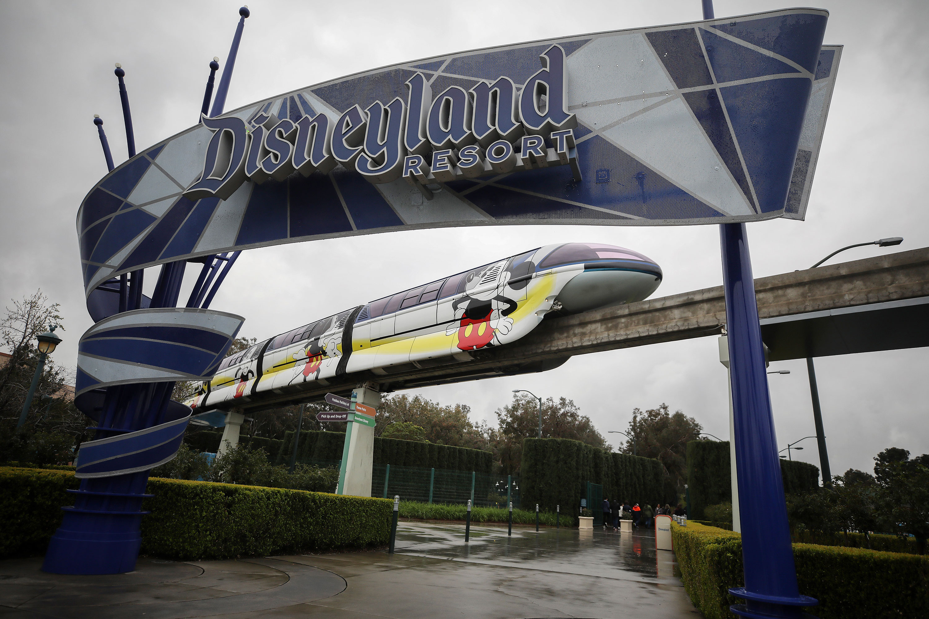 The monorail passes an entrance gate to Disneyland in Anaheim, California, on March 13.