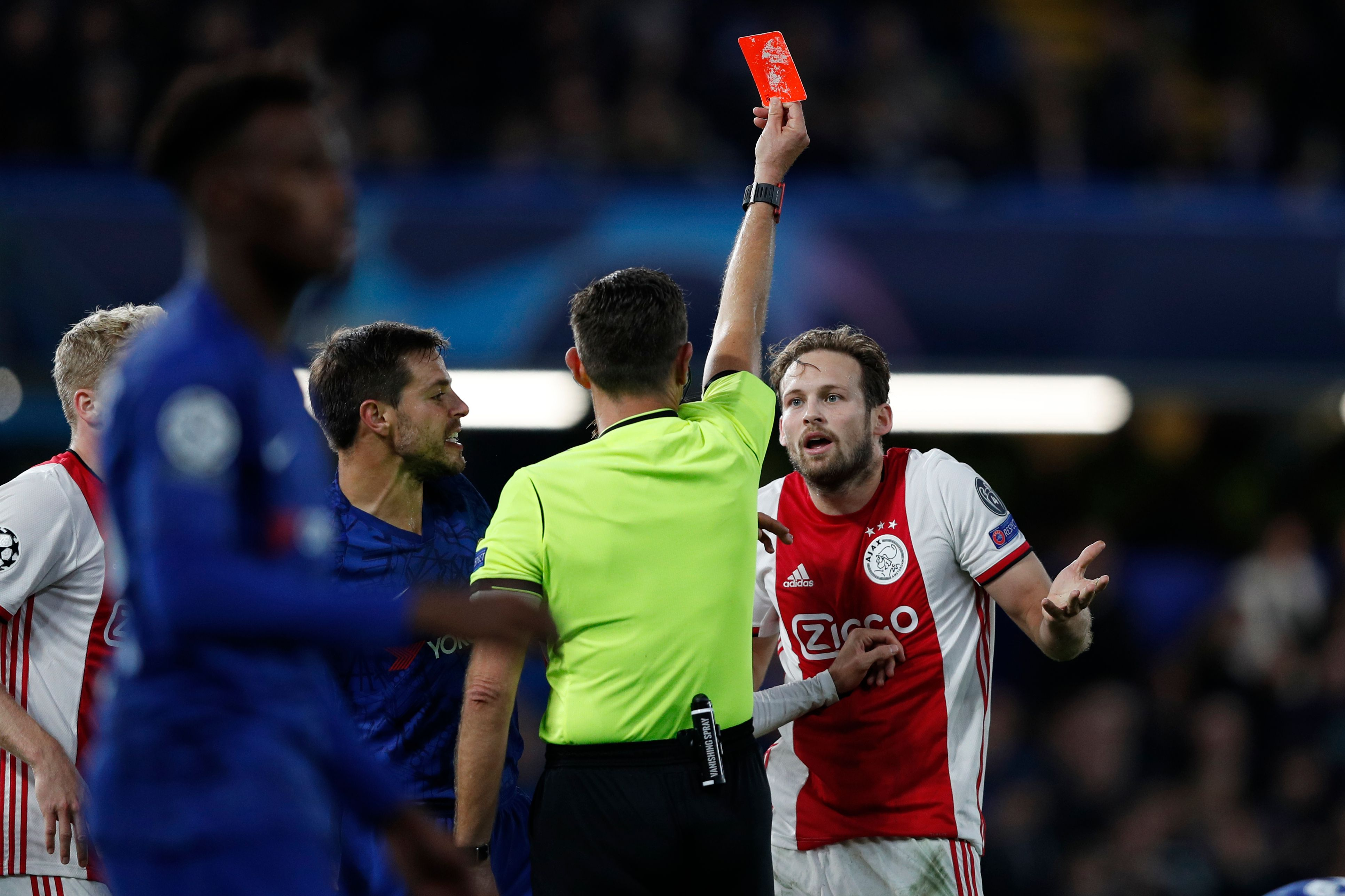 Ajax's Dutch defender Daley Blind (R) reacts as he is shown a red card by Italian referee Gianluca Rocch